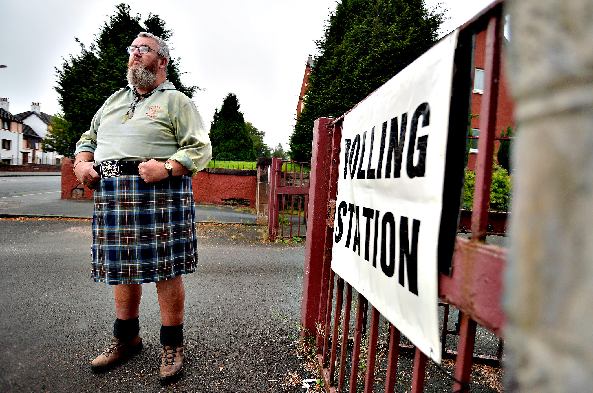 Yes voter Duncan Thomson waits for the doors to open at St Martins Church hall polling station, as the people of Scotland take to the poles to decide whether Scotland should become an independent country, on September 18, 2014 in Renton, Scotland. After many months of campaigning, final opinion poles show the referendum result is still  too close to call.
