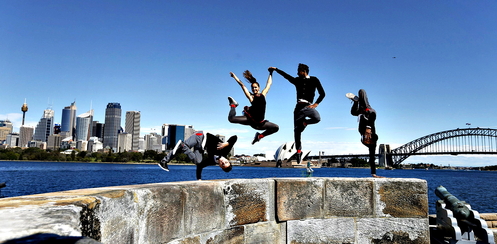 Members of the Red Bull Flying Bach dance troupe perform on Sydney Harbour's Fort Denison during a photo call, in Sydney September 9, 2014. The group, in Australia as part of their world tour, perform acrobatic dance to the classical music of German composer Johann Sebastian Bach with combined with electronic beats. Pictured are (L-R) Tim Mandriamanantena, Anna Holmstrom, Nordine-Dany Grimah and Yamine Manaa.