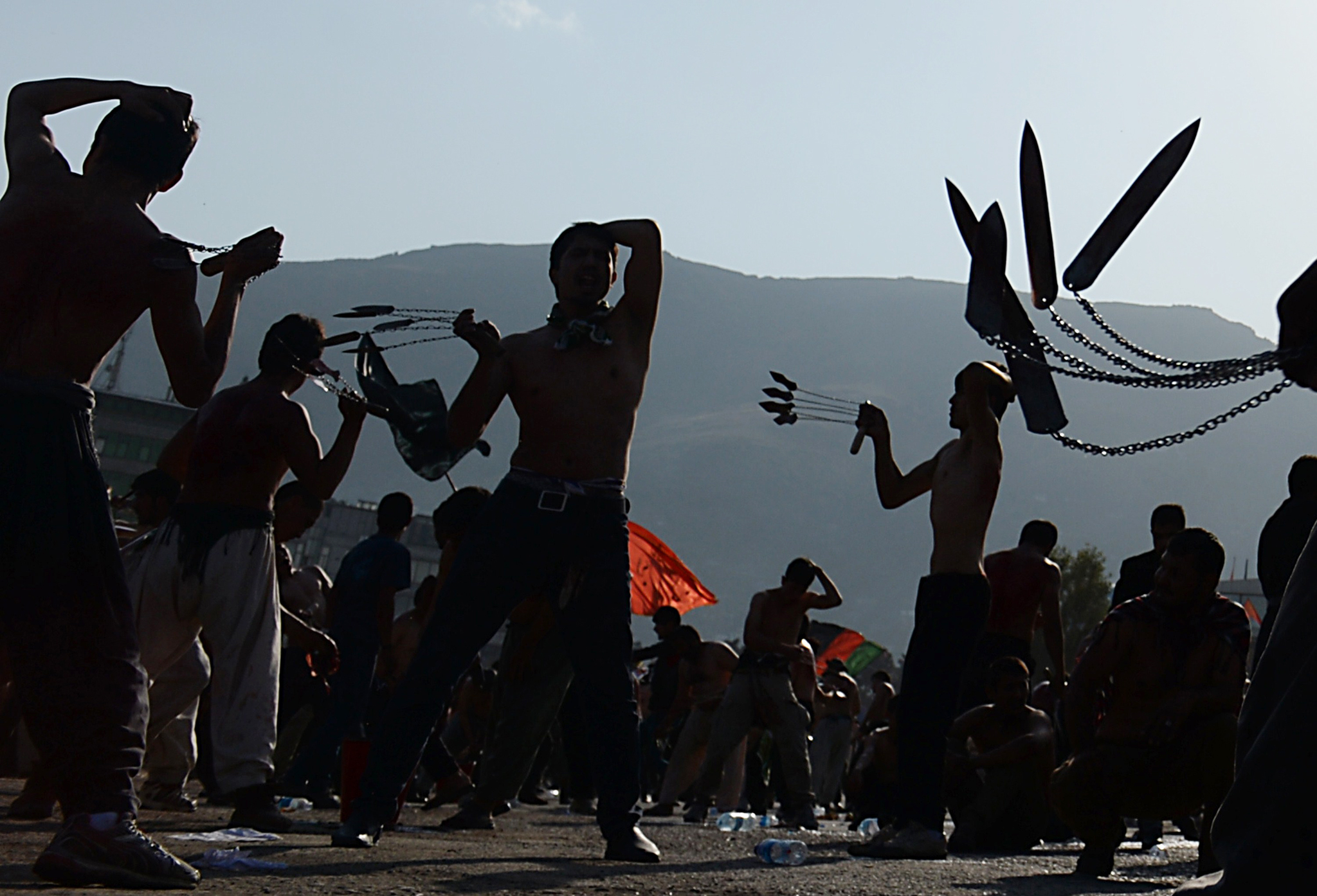 Afghan Shiites devotees beat themselves with chains and blades during commemorations ahead of the Day of Ashura in Kabul on October 30, 2014. Ashura mourns the death of Imam Hussein, a grandson of the Prophet Mohammed, who was killed by armies of the Yazid near Karbala in 680 AD