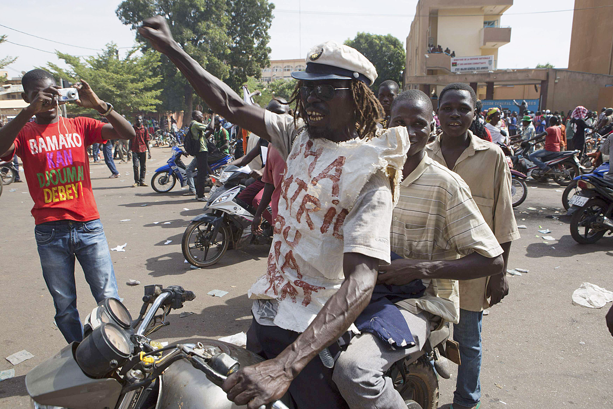 People celebrate the departure of Burkina Faso's President Blaise Compaore in Ouagadougou...People celebrate the departure of Burkina Faso's President Blaise Compaore in Ouagadougou, capital of Burkina Faso, October 31, 2014. General Honore Traore, the head of Burkina Faso's armed forces, took power on Friday after Compaore resigned amid mass demonstrations against an attempt to extend his 27-year rule in the West African country. REUTERS/Joe Penney (BURKINA FASO - Tags: POLITICS CIVIL UNREST)