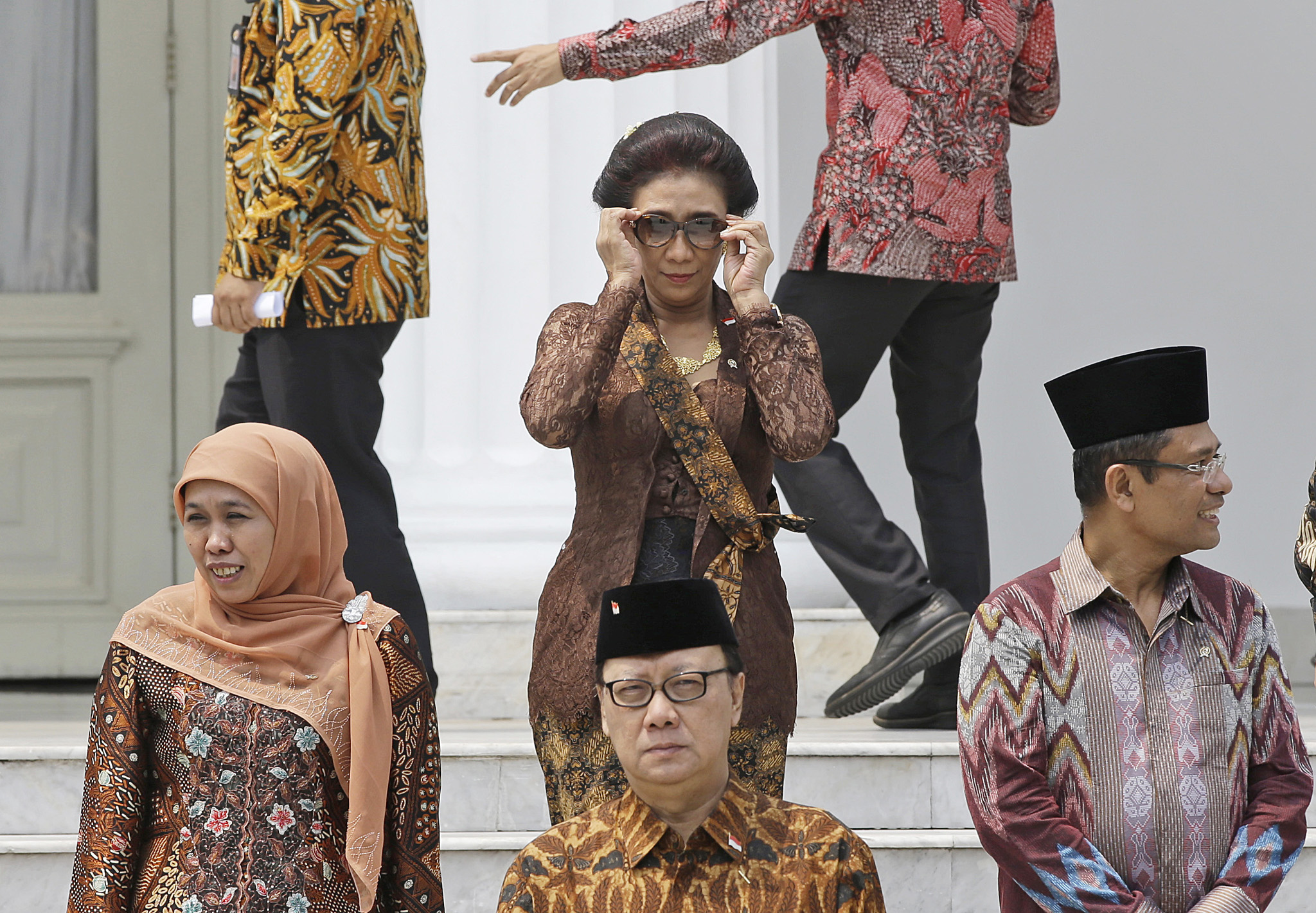 Susi Pudjiastuti...Indonesian Maritime and Fisheries Minister Susi Pudjiastuti, center, adjusts her sunglasses as she prepares for a photo session after the inauguration ceremony for the newly appointed Cabinet members at the presidential palace in Jakarta, Indonesia, Monday, Oct. 27, 2014