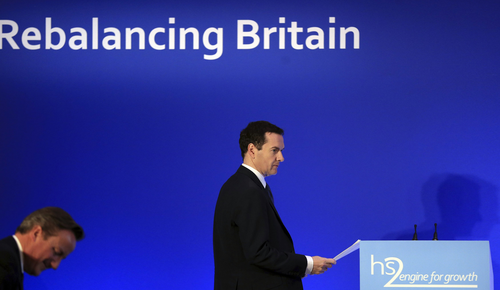 Chancellor George Osborne prepares to speak on high speed rail link HS2, at the launch of the HS2 report, in Leeds Civic Hall...Chancellor George Osborne prepares to speak on high speed rail link HS2, at the launch of the HS2 report, in Leeds Civic Hall, northern England October 27, 2014.     REUTERS/Lynne Cameron/Pool   (BRITAIN - Tags: BUSINESS POLITICS TRANSPORT)