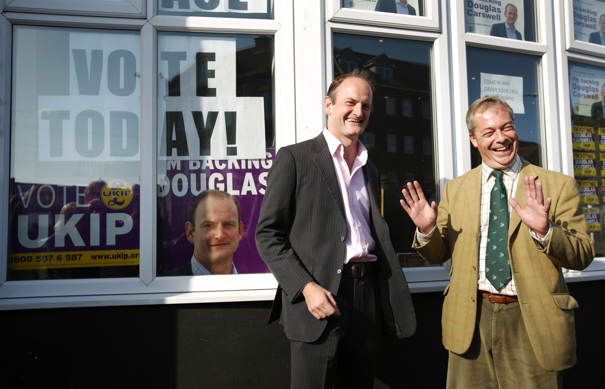 Clacton-On-Sea Parliamentary By-Election...CLACTON-ON-SEA, ENGLAND - OCTOBER 09:  United Kingdom Independence Party (UKIP) candidate Douglas Carswell (L) stands with party leader Nigel Farage on October 9, 2014 in Clacton-on-Sea, England.  Polls have opened in the by-election which is being held after the sitting Conservative party Member of Parliament Douglas Carswell defected to UKIP.  (Photo by Peter Macdiarmid/Getty Images)