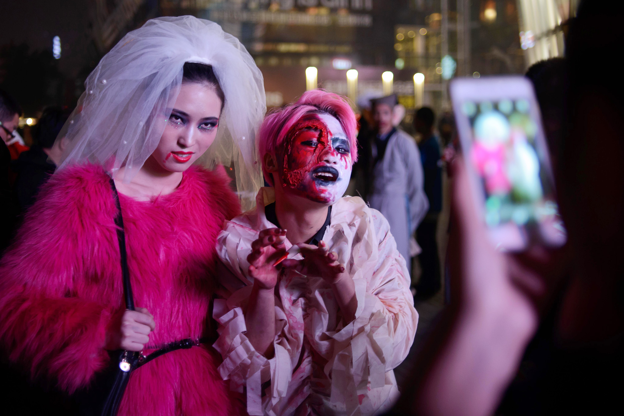 CHINA-LIFESTYLE-HALLOWEEN...Revellers in costume pose for photos as they celebrate Halloween in Beijing on October 31, 2013. AFP PHOTO / ED JONES        (Photo credit should read Ed Jones/AFP/Getty Images)
