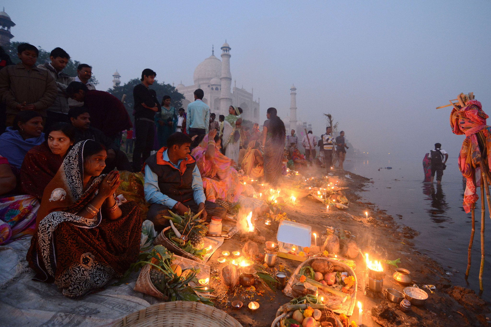 Indian Hindu devotees offer prayers on t...Indian Hindu devotees offer prayers on the banks of the Yamuna river as the landmark Taj Mahal monument is seen in the background during daybreak in Agra on October 30, 2014. Devotees pay obeisance to both the rising and the setting sun in the Chhath festival when people express their thanks and seek the blessings of the forces of nature, mainly the sun and river. AFP PHOTO/ PUNIT PARANJPESTRDEL/AFP/Getty Images