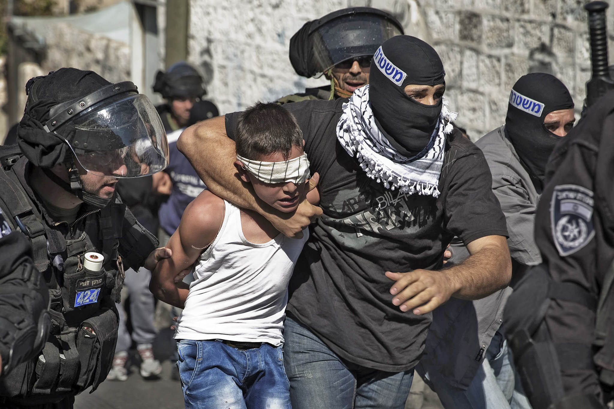 Israeli police detain Palestinian youth following clashes after Friday prayers in East Jerusalem neighbourhood of Wadi al-Joz
