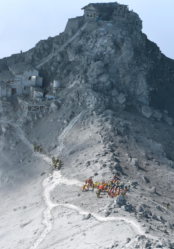 aerial...Rescuers conduct a search operation near the peak of Mount Ontake in central Japan Wednesday, Oct. 1, 2014. Search efforts for people missing since Saturday's surprise eruption resumed Wednesday morning. (AP Photo/Kyodo News) JAPAN OUT, MANDATORY CREDIT