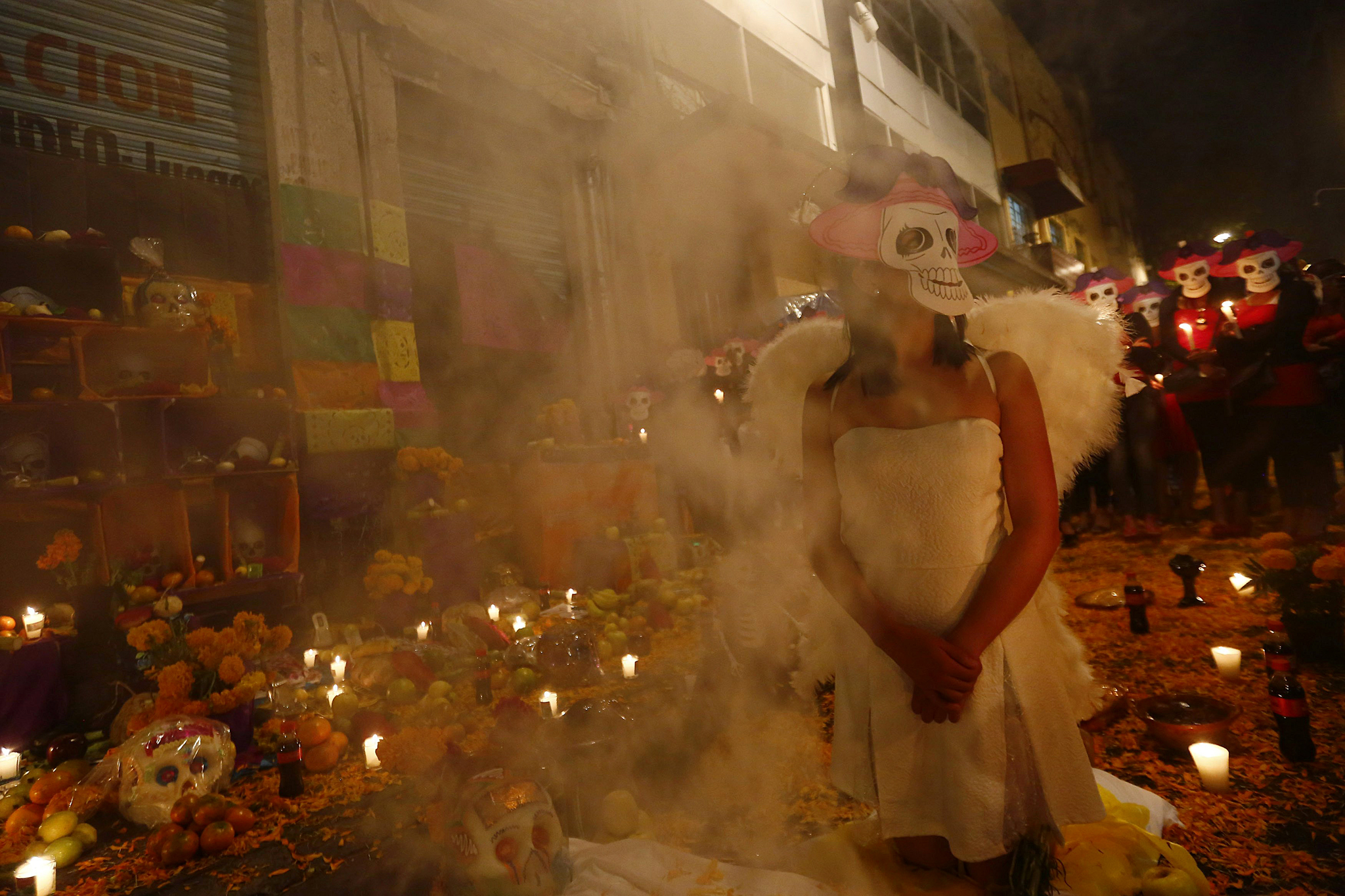 Sex workers wear skeleton masks as they make an offering during a procession to remember their deceased colleagues in Mexico City...Sex workers wear skeleton masks, a traditional Mexican symbol representing the Day of the Dead, as they make an offering during a procession to remember their deceased colleagues, especially those who were violently murdered, in Mexico City October 27, 2014. The annual Day of the Dead is observed on November 1 and 2. REUTERS/Edgard Garrido (MEXICO - Tags: RELIGION SOCIETY)