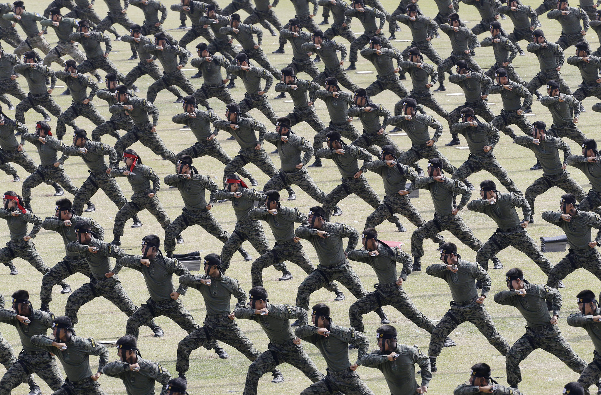 South Korean army soldiers demonstrate their martial arts skills during the 66th anniversary of Armed Forces Day at the Gyeryong military headquarters in Gyeryong, South Korea,