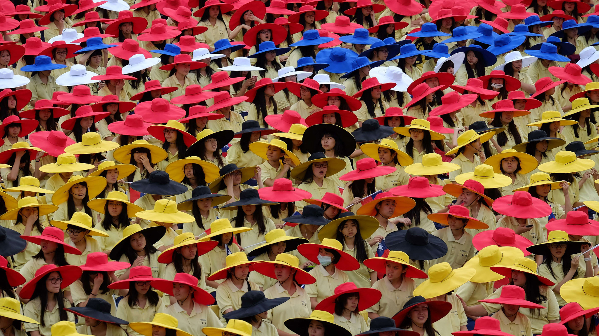 Students wear colorful hats during the national day anniversary in front of the Presidential Palace in Taipei