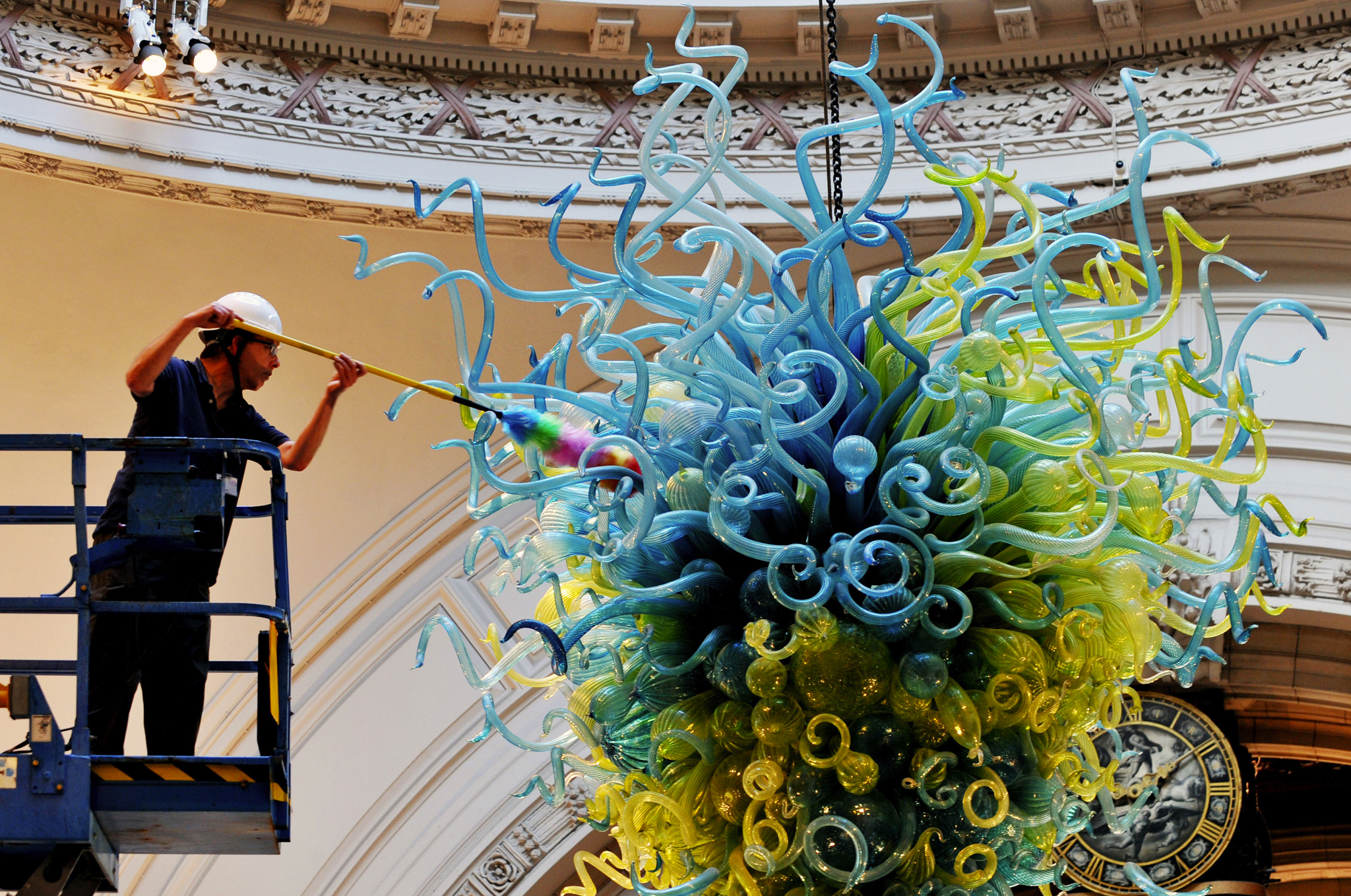 Albert Museum technical service member Andy Monks cleans the Rotunda Chandelier by Dale Chihuly to complete the cleaning of the Dome in the Museum's Grand Entrance in Cromwell Road, west London.