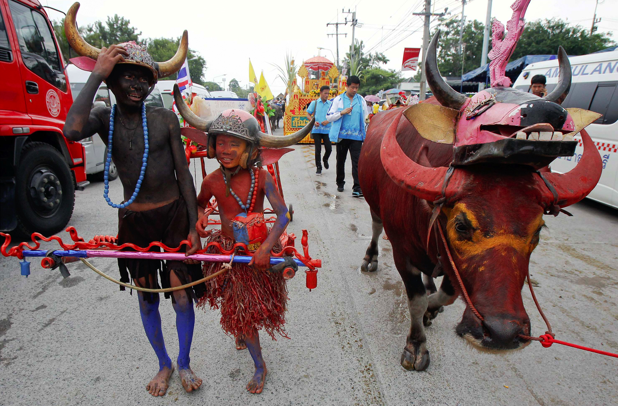 Boys wearing horned helmets and body paint arrive for Chonburi's annual buffalo race festival, east of Bangkok. The event, which also celebrates the rice harvest, dates back to the buffalo trade in Chonburi, once the commercial centre of Thailand's east.