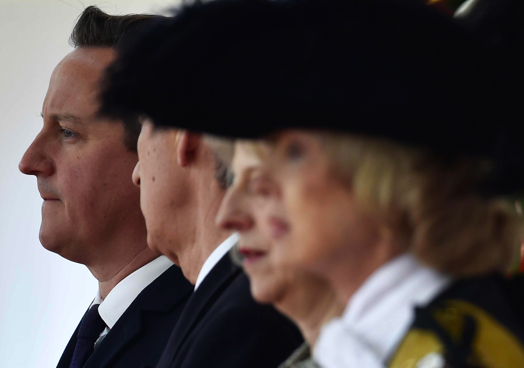 Britain's Prime Minister David Cameron (L) attends a ceremonial welcome for the President of Singapore Tony Tan, and his wife, at Horse Guards Parade in London. The President and his wife will be guests of Queen Elizabeth during the first state visit of a Singapore President to Britain.
