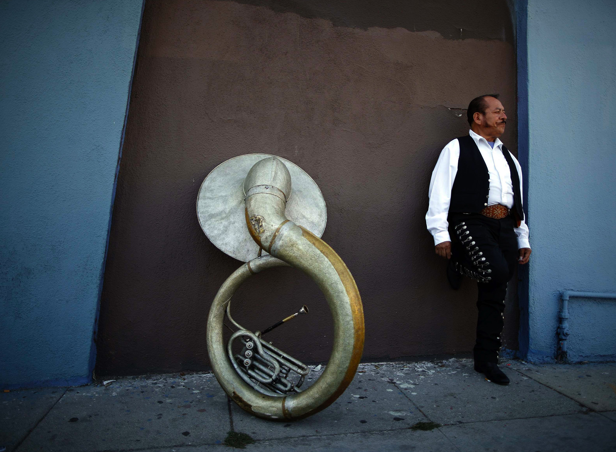 Mariachi musician Moises Rivera, 60, waits for a gig in the Boyle Heights area of Los Angeles, home to many Mexican and Central American migrants, in California.