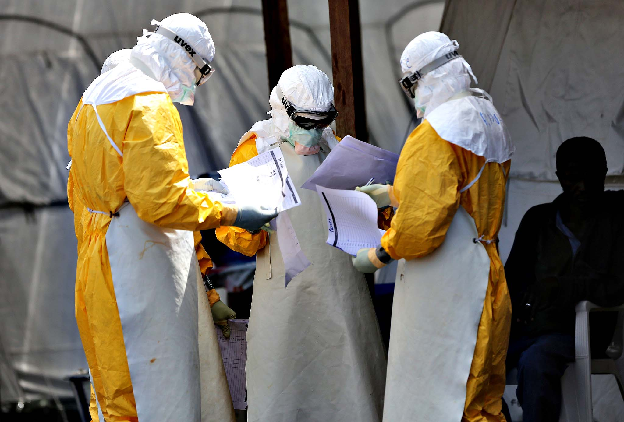 Health workers at Doctors Without Borders (MSF), work in the high-risk area of the ELWA 3 Ebola treatment center on October 16, 2014 in Paynesville, Liberia. The World Health Organization says that more than 4,500 people have died due to the Ebola epidemic in West Africa with a mortality rate for the disease at about 70 percent.