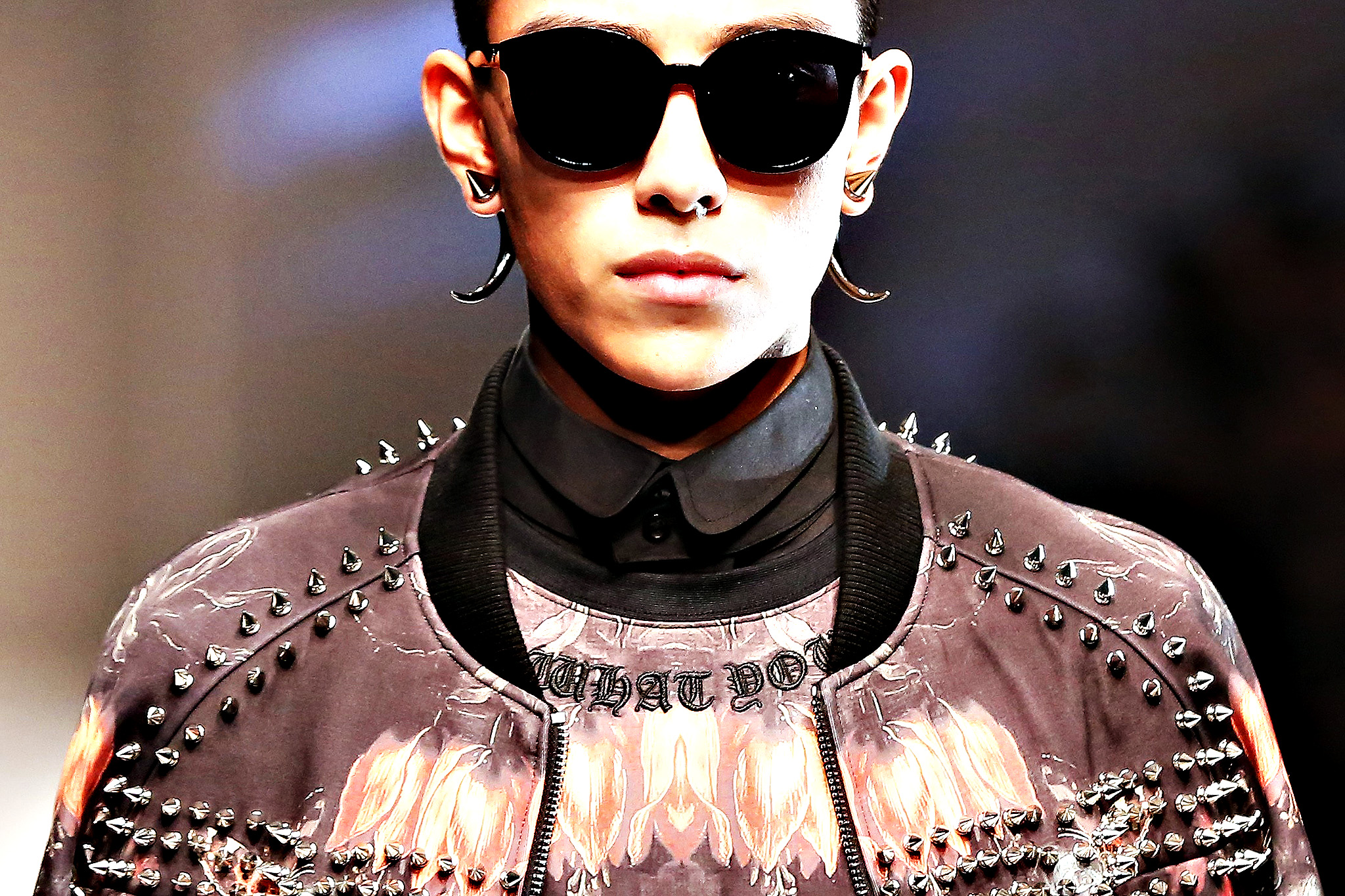 A model presents a creation by Jonny Fu during Shanghai Fashion Week in Shanghai October 17, 2014.