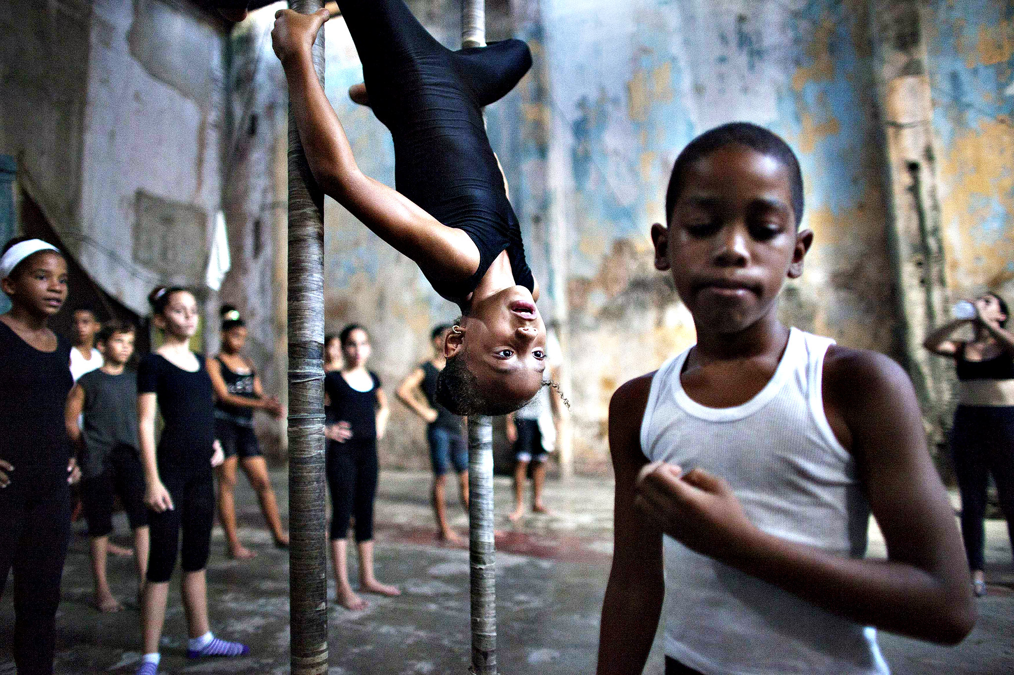 Children practise during a training session at a circus school in Havana. Inside an abandoned movie theatre on a noisy avenue in a working-class section of Havana, some 70 Cuban children as young as nine pursue their dream of joining the circus. The circus is a lucrative career path and a rare opportunity for Cubans to make real money on the communist-led island.