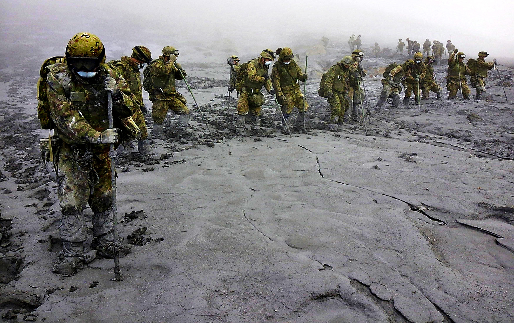 JSDF soldiers conduct rescue operations on Mount Ontake, which erupted on September 27, 2014 and straddles Nagano and Gifu prefectures in central Japan...Japan Self-Defense Force (JSDF) soldiers conduct rescue operations on Mount Ontake, which erupted September 27, 2014 and straddles Nagano and Gifu prefectures in central Japan, in this October 7, 2014 handout photograph released by the Joint Staff of the Defence Ministry of Japan. Two more bodies were found on Mount Ontake on Tuesday, nearly a week and a half after the eruption that killed at least 51 people, Japanese media reported. The search continues for 10 people still missing in what has become the nation's worst volcanic disaster in a century.