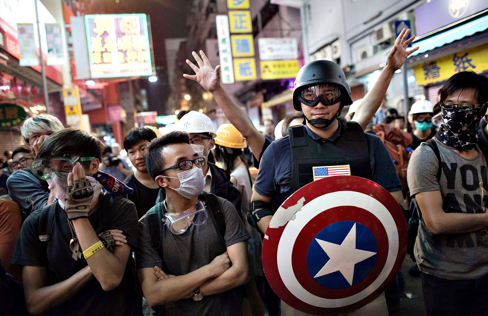 Pro-democracy protesters stand their ground on a barricaded road in the Mongkok district of Hong Kong on October 23, 2014. Major intersections in the southern Chinese city have been paralysed by mass rallies demanding free elections for more than three weeks, in one of the biggest challenges to Beijing's authority since the Tiananmen pro-democracy protests of 1989.