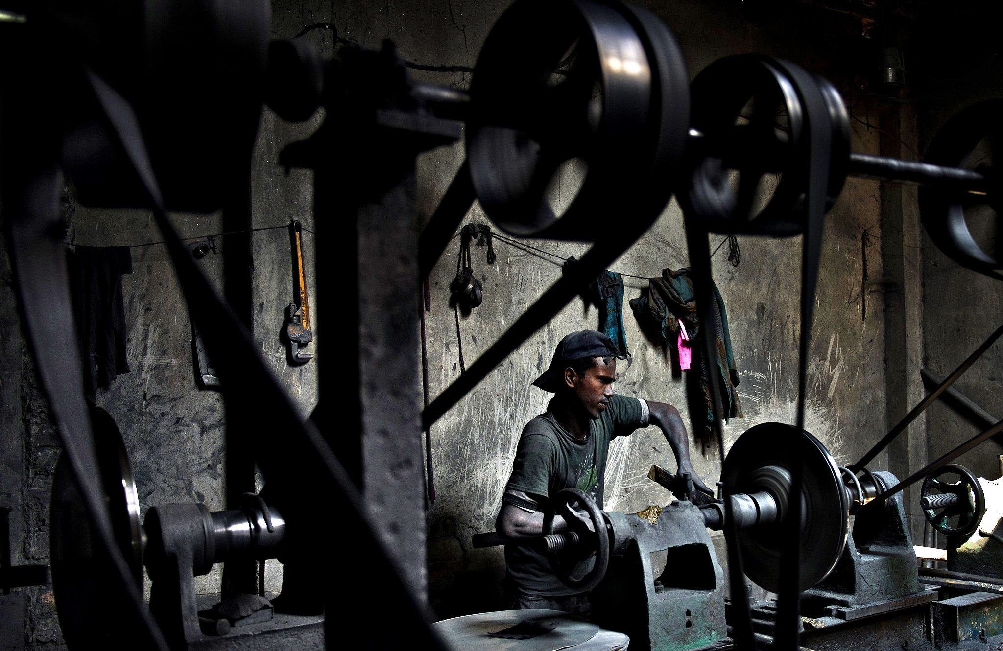 A Bangladeshi child labourer works at an aluminium pot factory in Dhaka on October 21, 2014. More than 6.3 million children under the age of 14 are working in Bangladesh, according to a UNICEF report on child labour.
