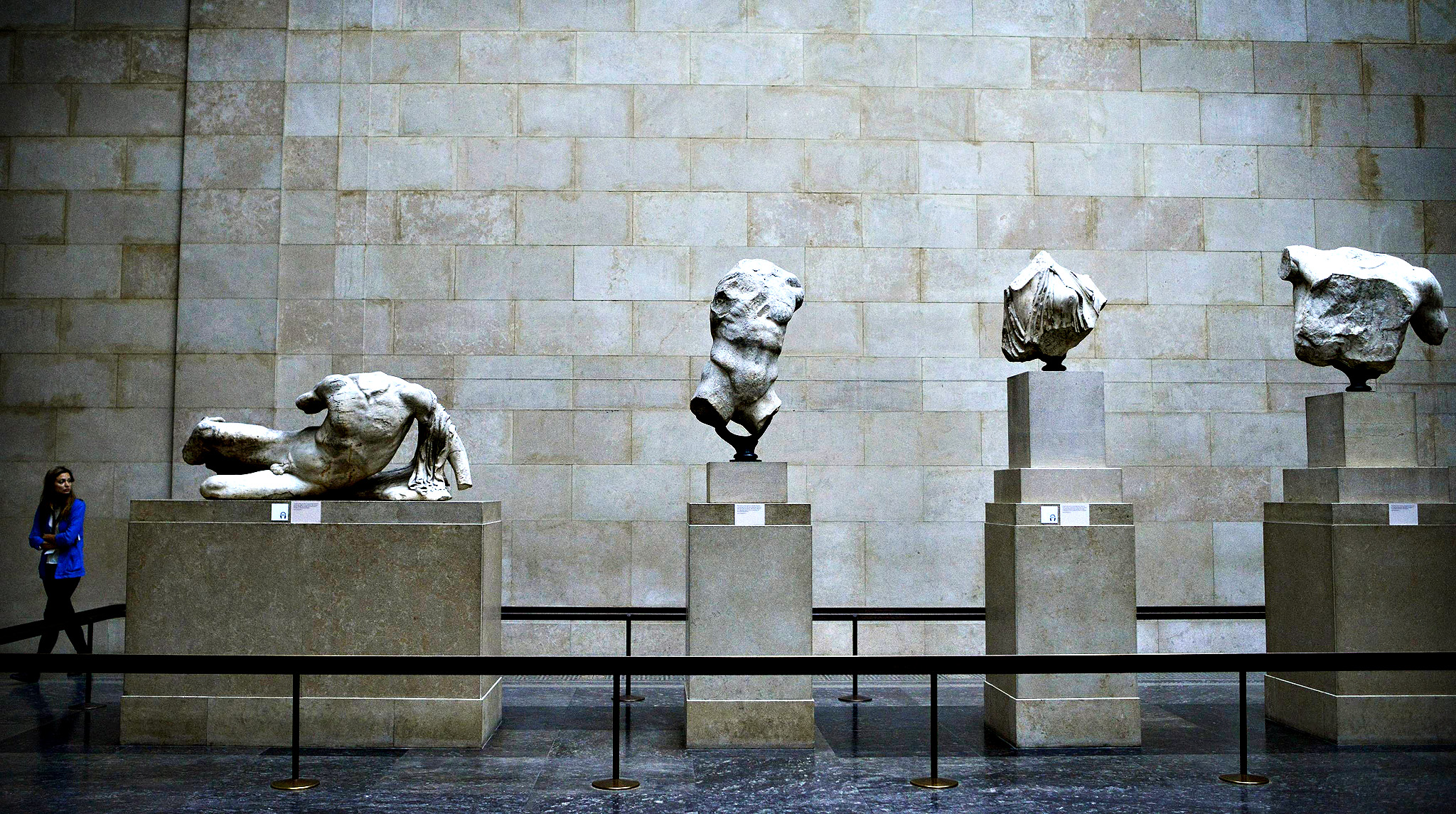 A woman looks at the Parthenon Marbles, a collection of stone objects, inscriptions and sculptures, also known as the Elgin Marbles, on show at the British Museum in London October 16, 2014. Hollywood actor George Clooney's new wife, human rights lawyer Amal Alamuddin Clooney, made an impassioned plea on for the return of the Parthenon Marbles to Athens, in what Greeks hope may inject new energy into their national campaign.