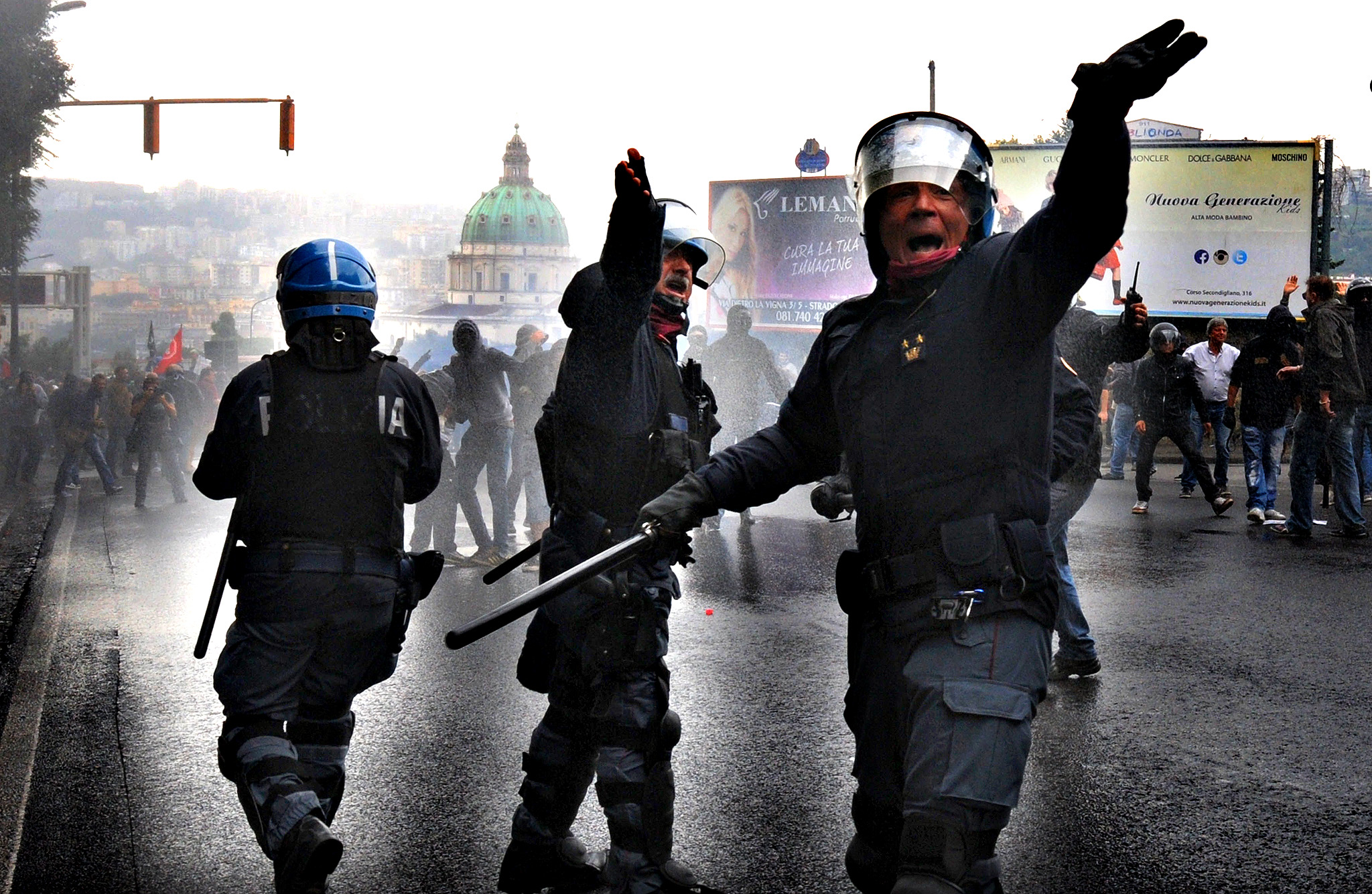 Anti-riot police clash with anti-austerity protesters near the Capodimonte museum during the Governing Council of the European Central Bank (ECB) on October 2, 2014 in Naples. Thousands of anti-austerity demonstrators rallied in Naples today as the European Central Bank convened in the Italian city to discuss how to avert looming deflation in the eurozone.