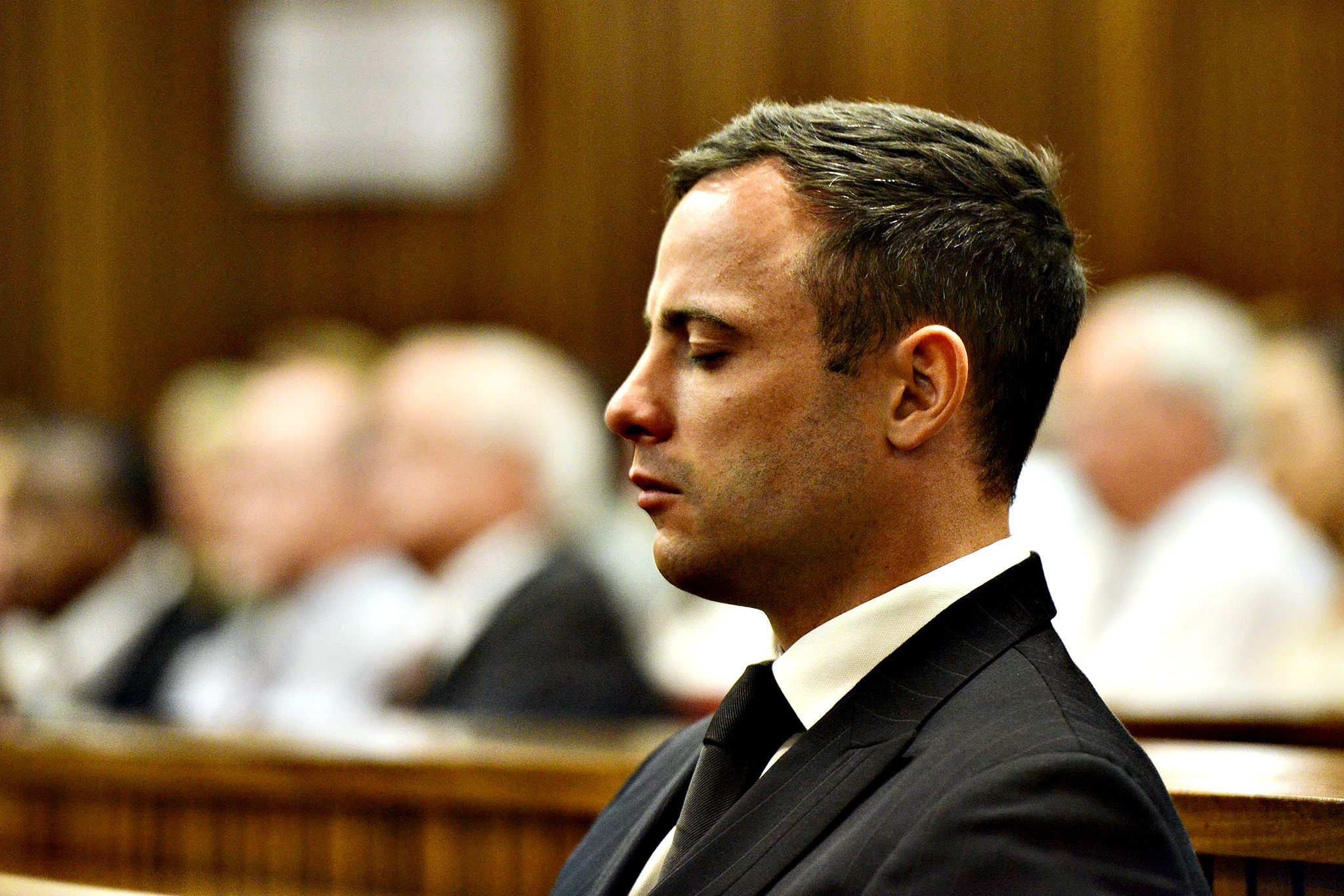 South African Paralympic athlete Oscar Pistorius at the High Court in Pretoria, South Africa, 21 October 2014. Pistorius was sentenced to 5 years in prison for killing his girlfriend Reeve Steenkamp in February 2013.