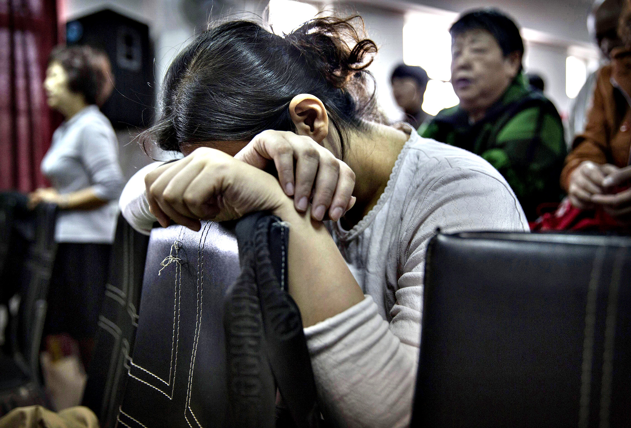 A Chinese Christian woman prays during a service at an underground independent Protestant Church in Beijing, China. China, an officially atheist country, places a number of restrictions on Christians and allows legal practice of the faith only at state-approved churches. The policy has driven an increasing number of Christians and Christian converts 'underground' to secret congregations in private homes and other venues. While the size of the religious community is difficult to measure, studies estimate there more than 65 million Christians inside China with studies supporting the possibility it could become the most Christian nation in the world within a decade.