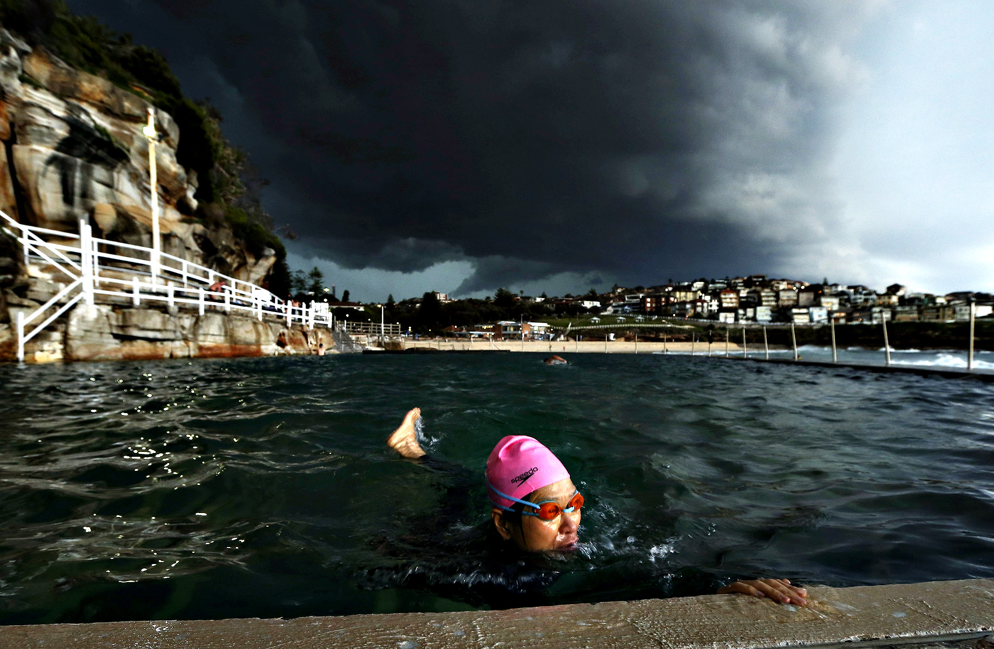 A swimmer swims laps in Bronte Ocean Pool as a severe storm hits Sydney at Bronte Beach on October 13, 2014 in Sydney, Australia.