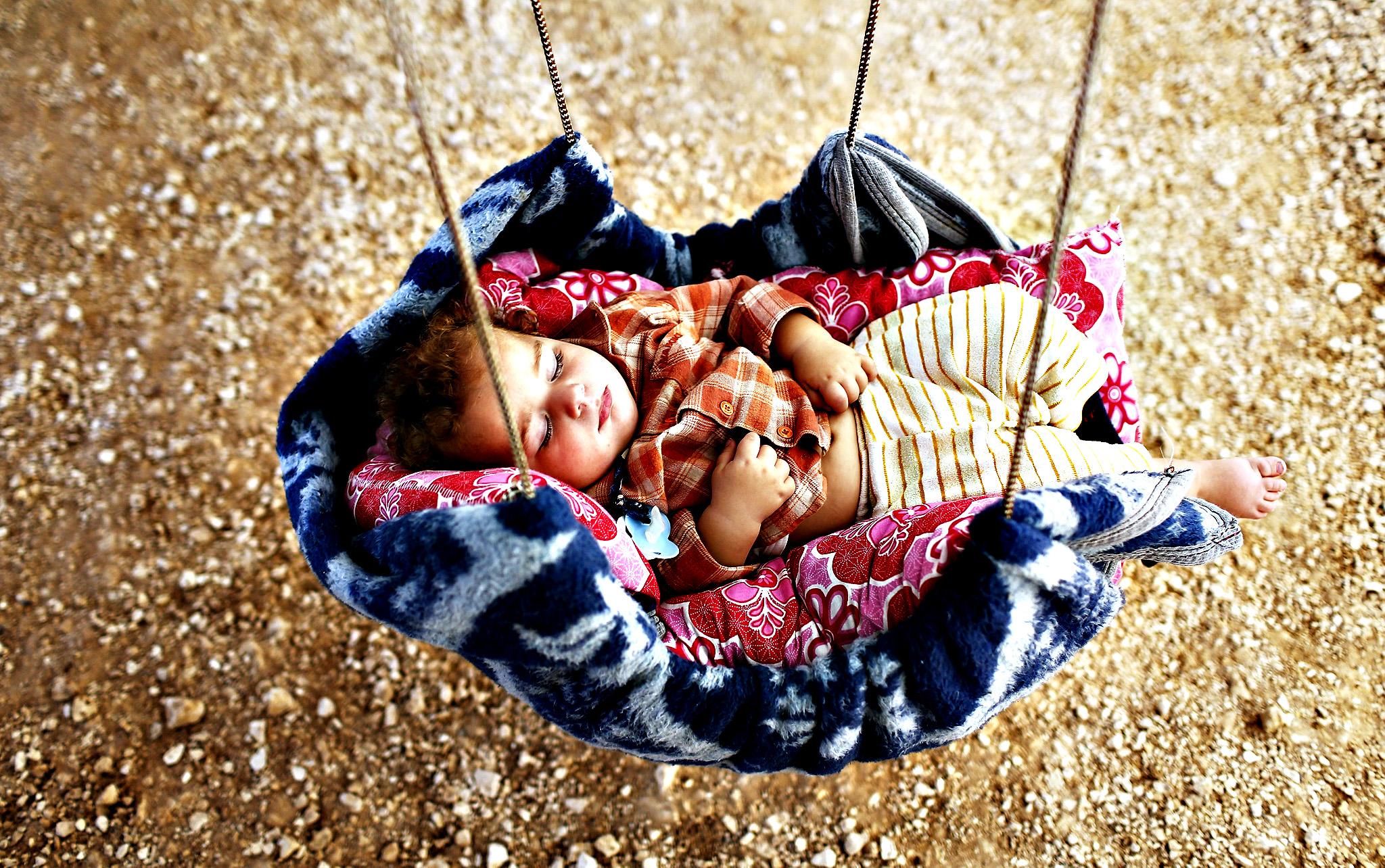 A Syrian toddler sleeps in a makeshift cradle installed in a tent set up for refugees in the Suruc district, near Sanliurfa, Turkey, 01 October 2014. Turkey according to the UN agency for refugees (UNHCR) is facing the 'biggest influx' of Syrian refugees since the start of the war three years ago. The fighting in the besieged Syrian border town of Kobane has pushed more than 160,000 Syrian refugees, mostly Kurds, into Turkey, raising the overall number of Syrian refugees in the country to about 1.5 million.