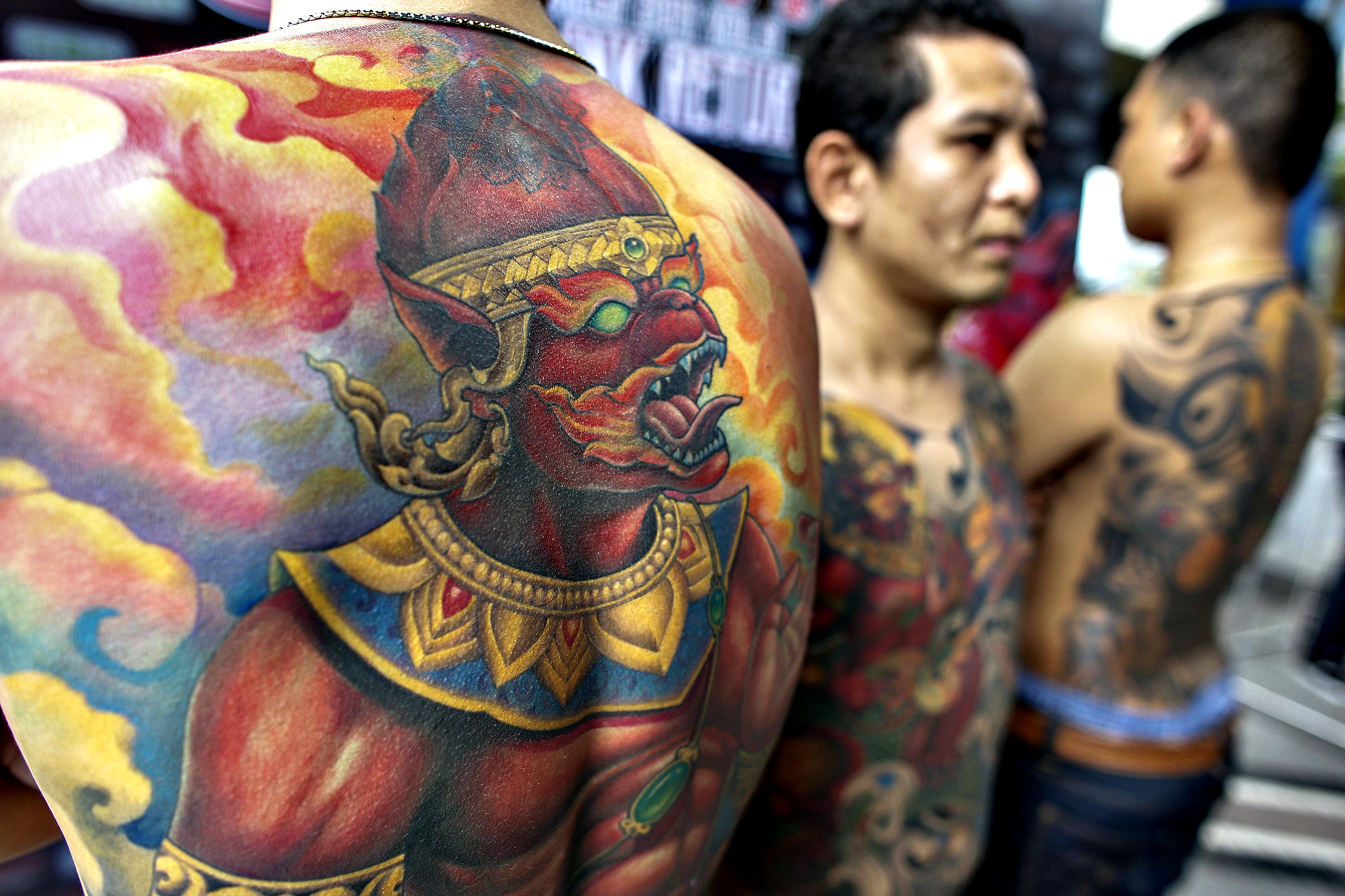 Competitors show their tattoos at the MBK Tattoo Contest 2014 in a shopping mall in Bangkok October 23, 2014.