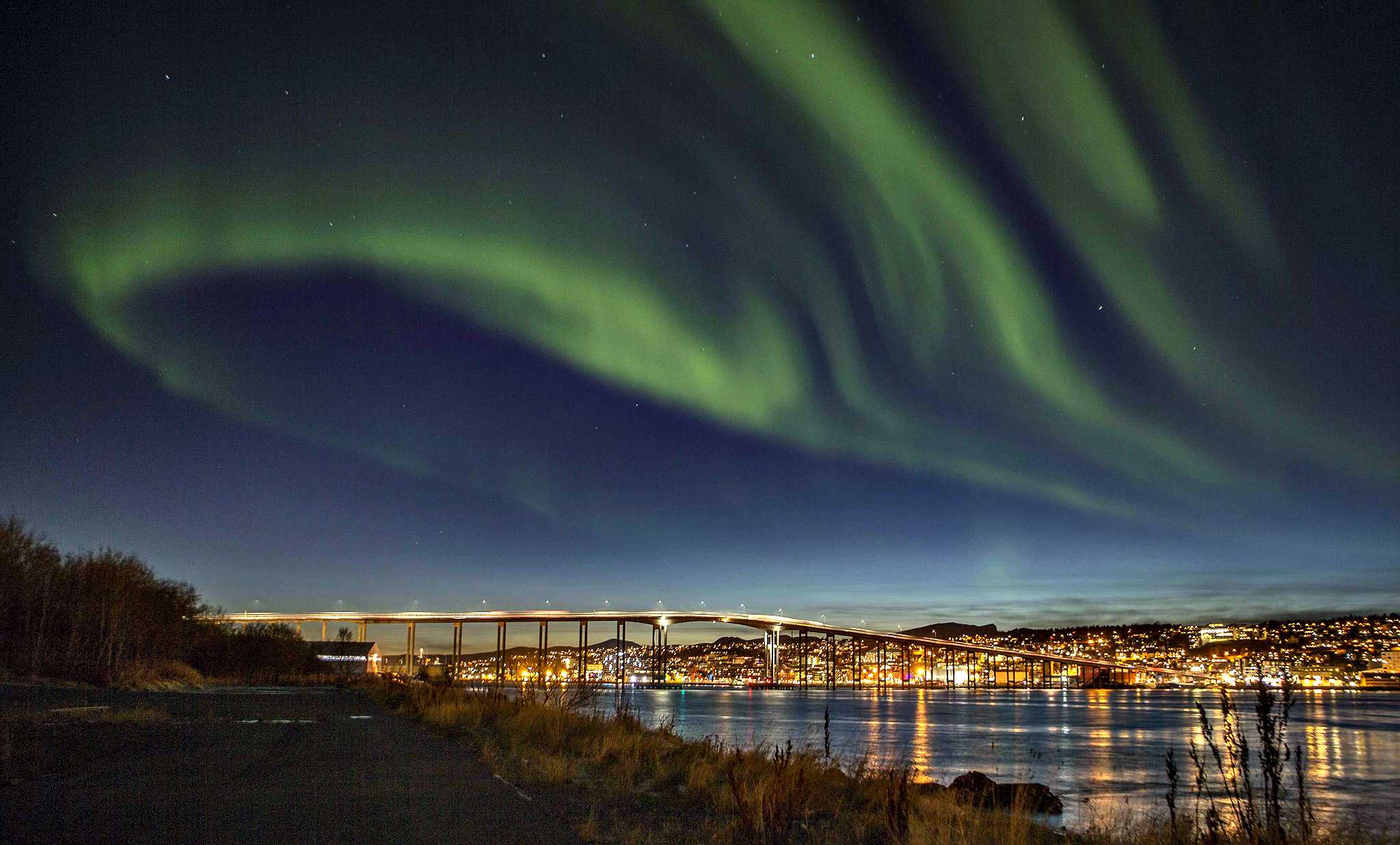 Northern lights (Aurora borelias) are seen over the city of Tromso in northern Norway.