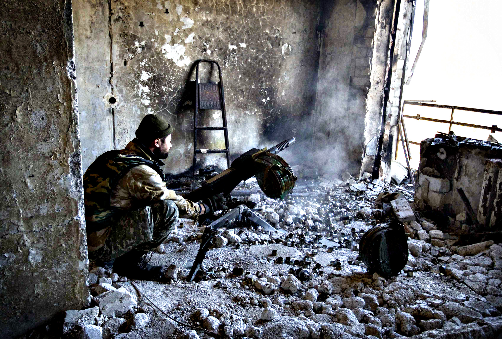 A pro-Russian separatist fires an automatic grenade launcher from his position during fighting with Ukrainian government forces near the Sergey Prokofiev International Airport in Donetsk...A pro-Russian separatist fires an automatic grenade launcher from his position during fighting with Ukrainian government forces near the Sergey Prokofiev International Airport in Donetsk, eastern Ukraine, October 9, 2014.