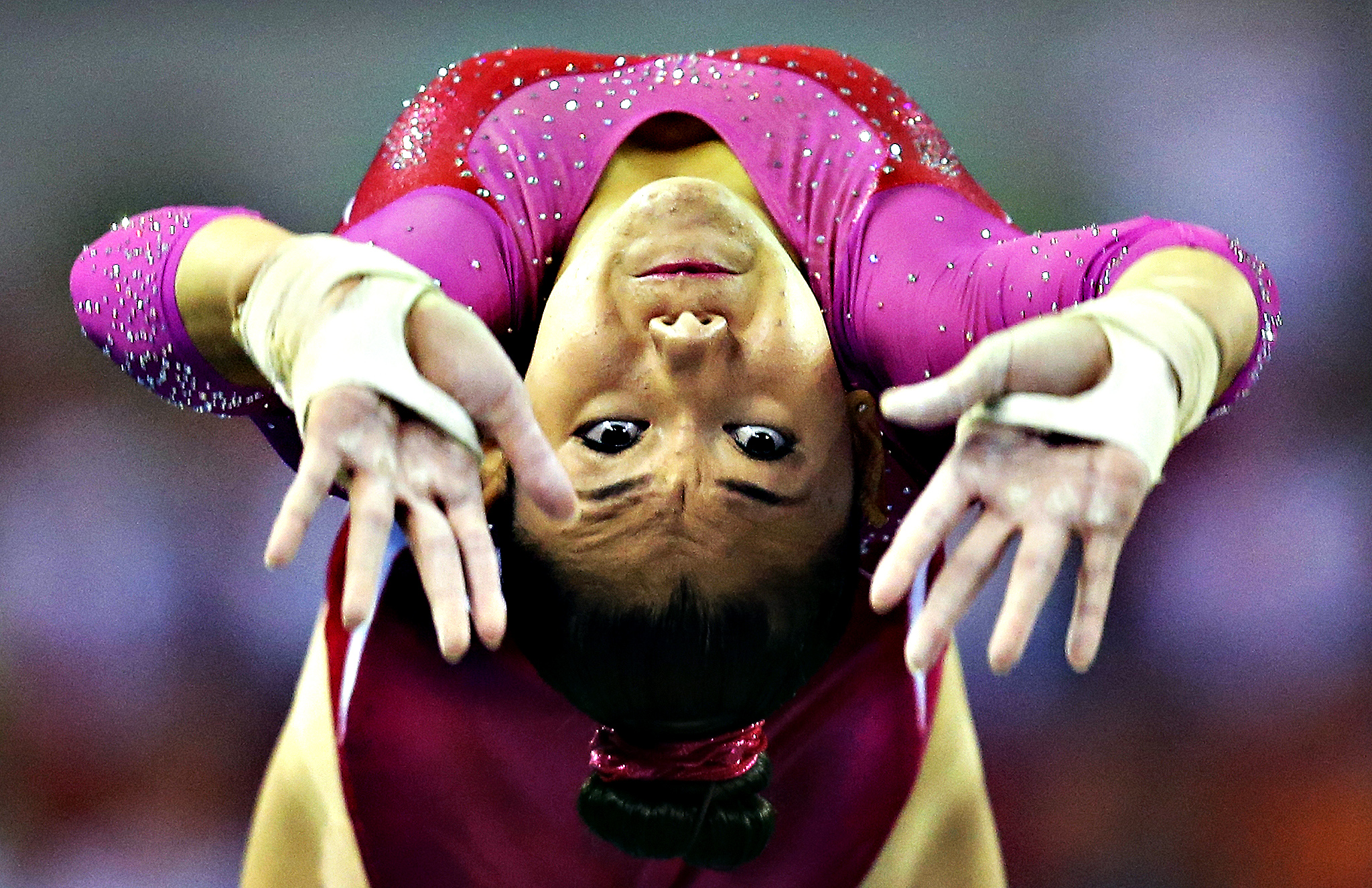 Kyla Ross of the United States jumps onto the vault as she competes in the women's all-round final of the Artistic Gymnastics World Championship at the Guangxi Gymnasium in Nanning, capital of southwest China's Guangxi Zhuang Autonomous Region Friday, Oct. 10, 2014.