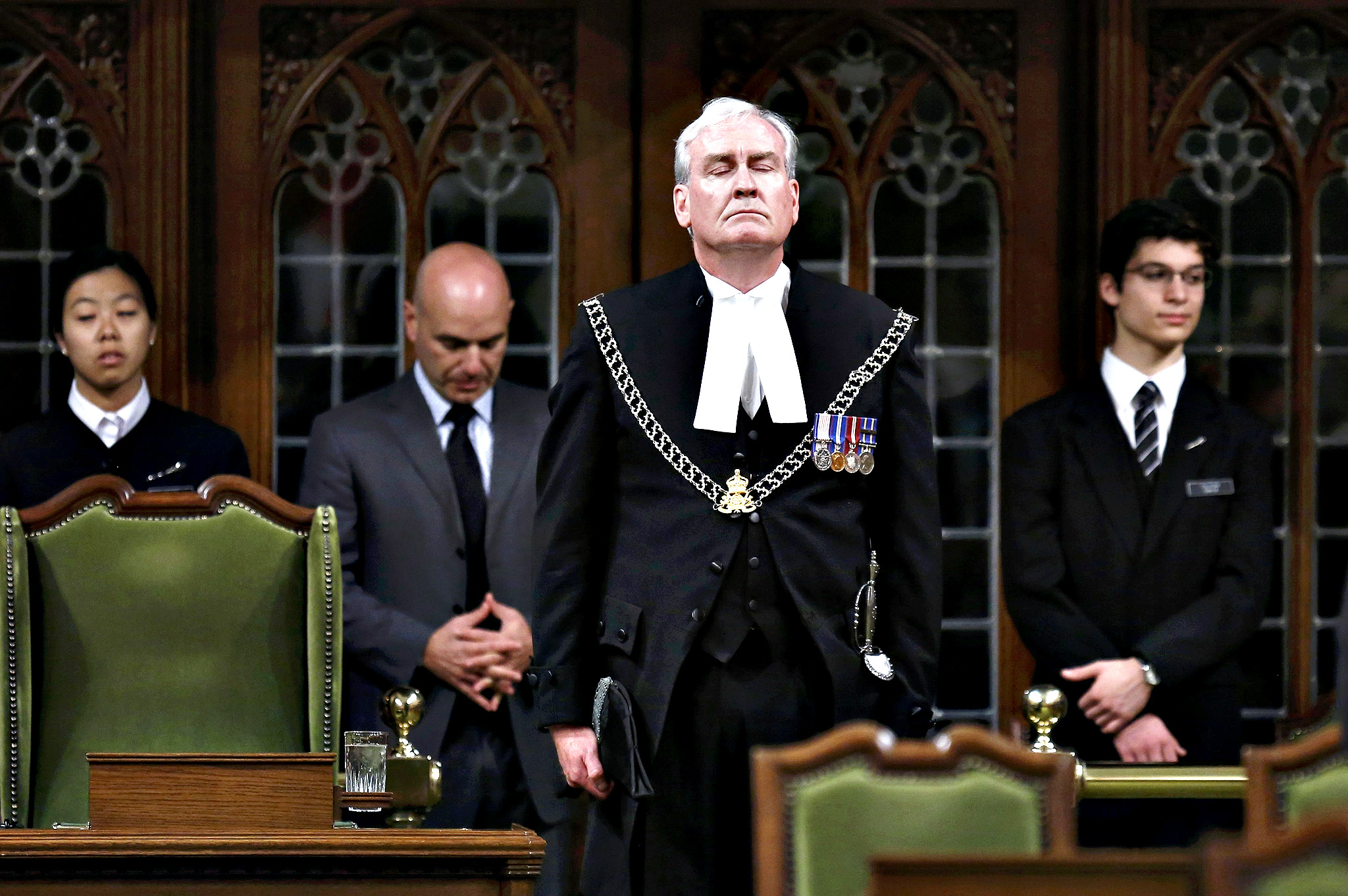 Canada's Sergeant-at-Arms Kevin Vickers is applauded in the House of Commons in Ottawa October 23, 2014. Vickers shot a gunman during an attack on the Parliament Buildings on October 22.