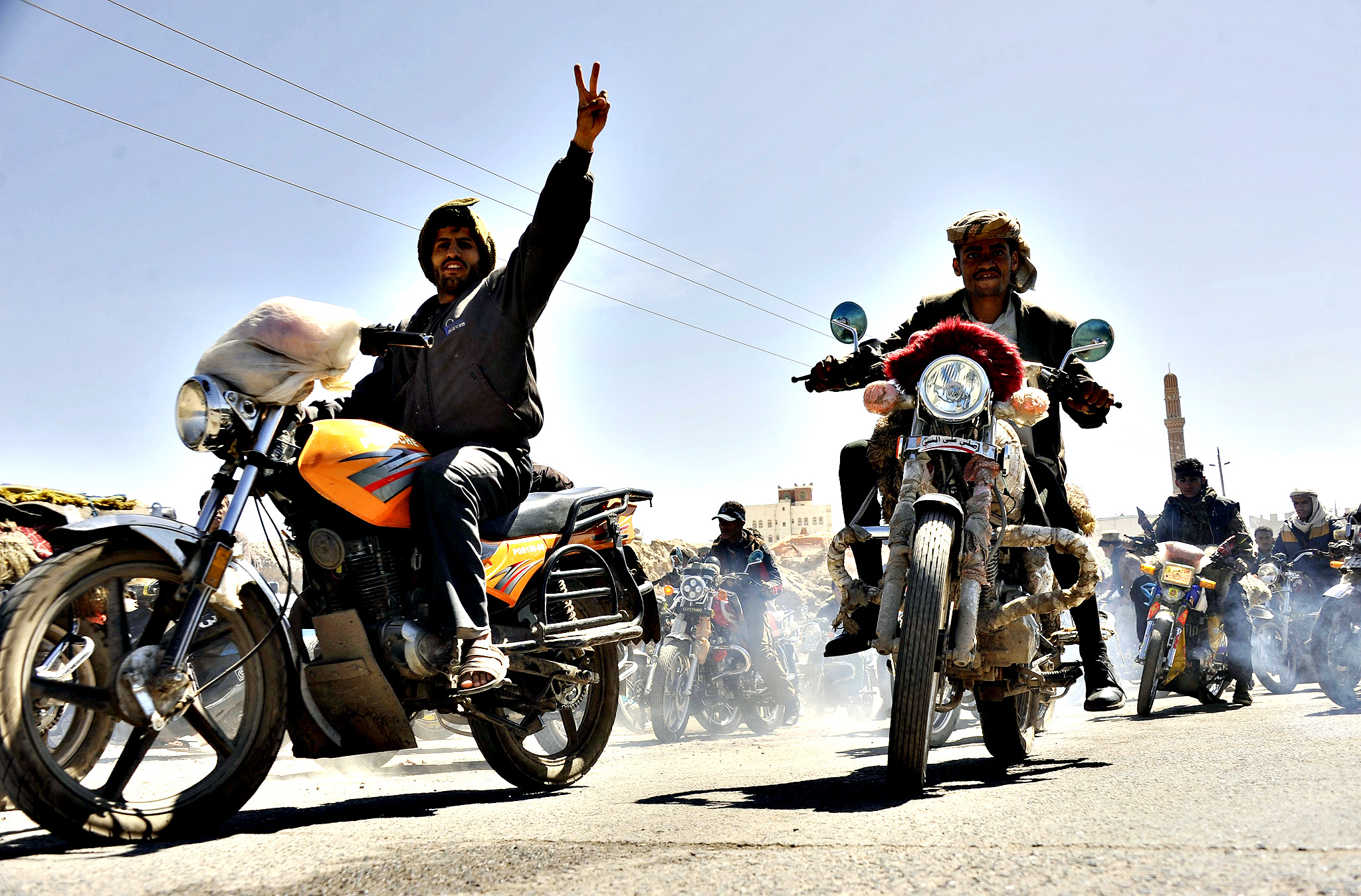 Motorcyclists take part in a protest against the Yemeni Government's decision to begin enforcing a long-standing motorbike ban, Sana a, Yemen, 23 October 2014. Reports state that amid increased insecurity resulting from a Houthi take over of the Yemeni capital 21 September and a string of attacks and assasinations carried out on senior army and security officials primarily utilising motorcylces as a form of transport the Yemeni Government has taken the decision to resume enforcing a ban on motorbikes.