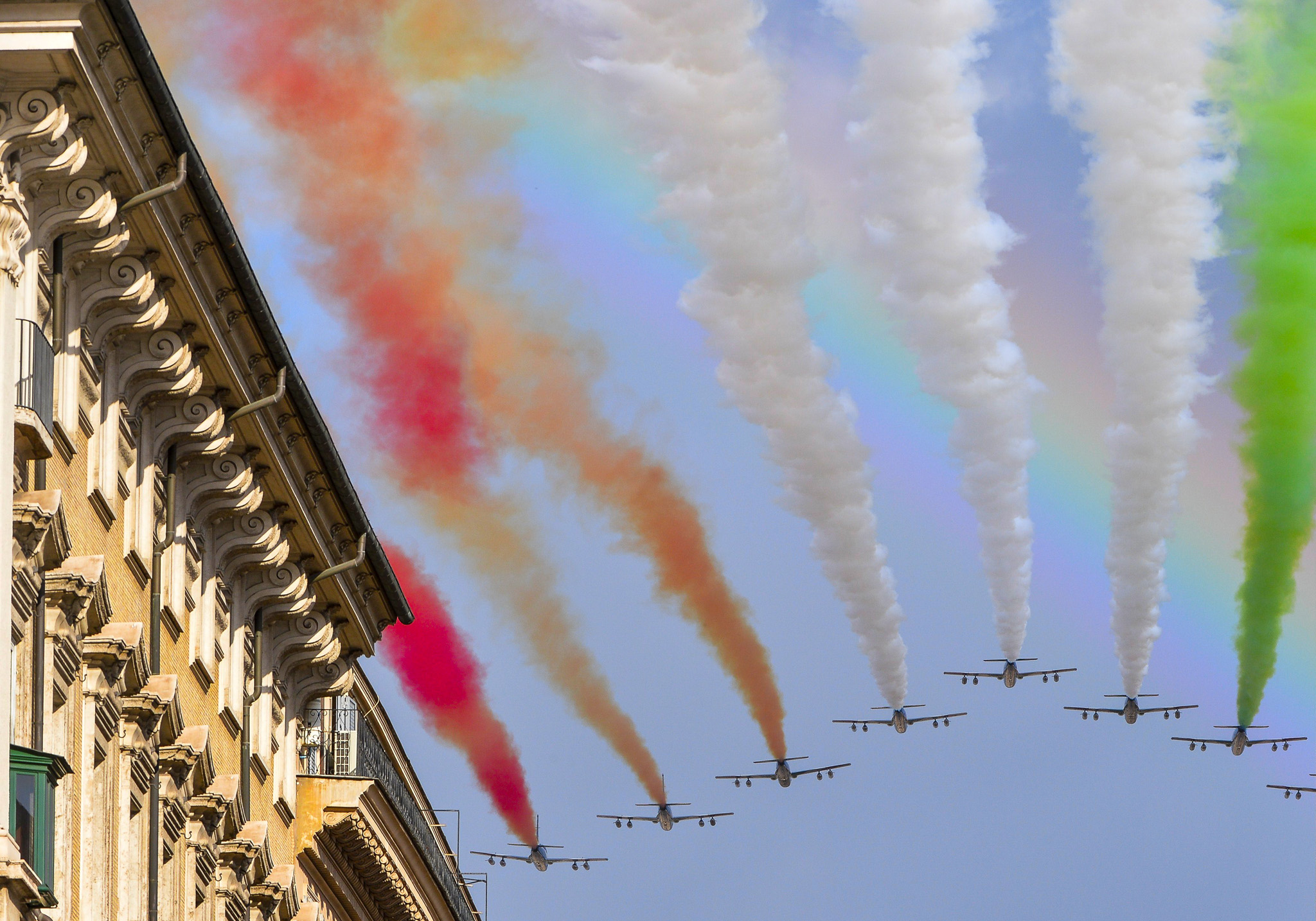 The Italian Air Force aerobatic unit Fre...The Italian Air Force aerobatic unit Frecce Tricolori (Tricolor Arrows) spreads smoke with the colors of the Italian flag over the Piazza Venezia as Italy celebrates today the National Unity Day and the Armed Forces Day which marks the end of World War I for Italy, on November 4, 2014 in Rome.  AFP PHOTO / ANDREAS SOLAROANDREAS SOLARO/AFP/Getty Images
