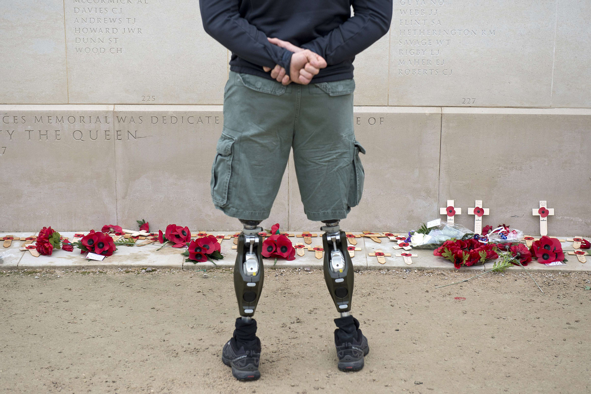 A member of the armed forces with prosth...A member of the armed forces with prosthetic legs pays his respects at the Armed Forces Memorial in the National Memorial Arboretum on Armistice Day near Lichfield, Staffordshire, central England, on November 11, 2014. In services around the country tributes were paid to the millions of British servicemen and women who have died in conflict since the start of the First World War 100 years ago. November 11 marks Armistice Day, the day on which a ceasefire came into effect in 1918 that ended the First World War on the Western Front.  AFP PHOTO / OLI SCARFFOLI SCARFF/AFP/Getty Images