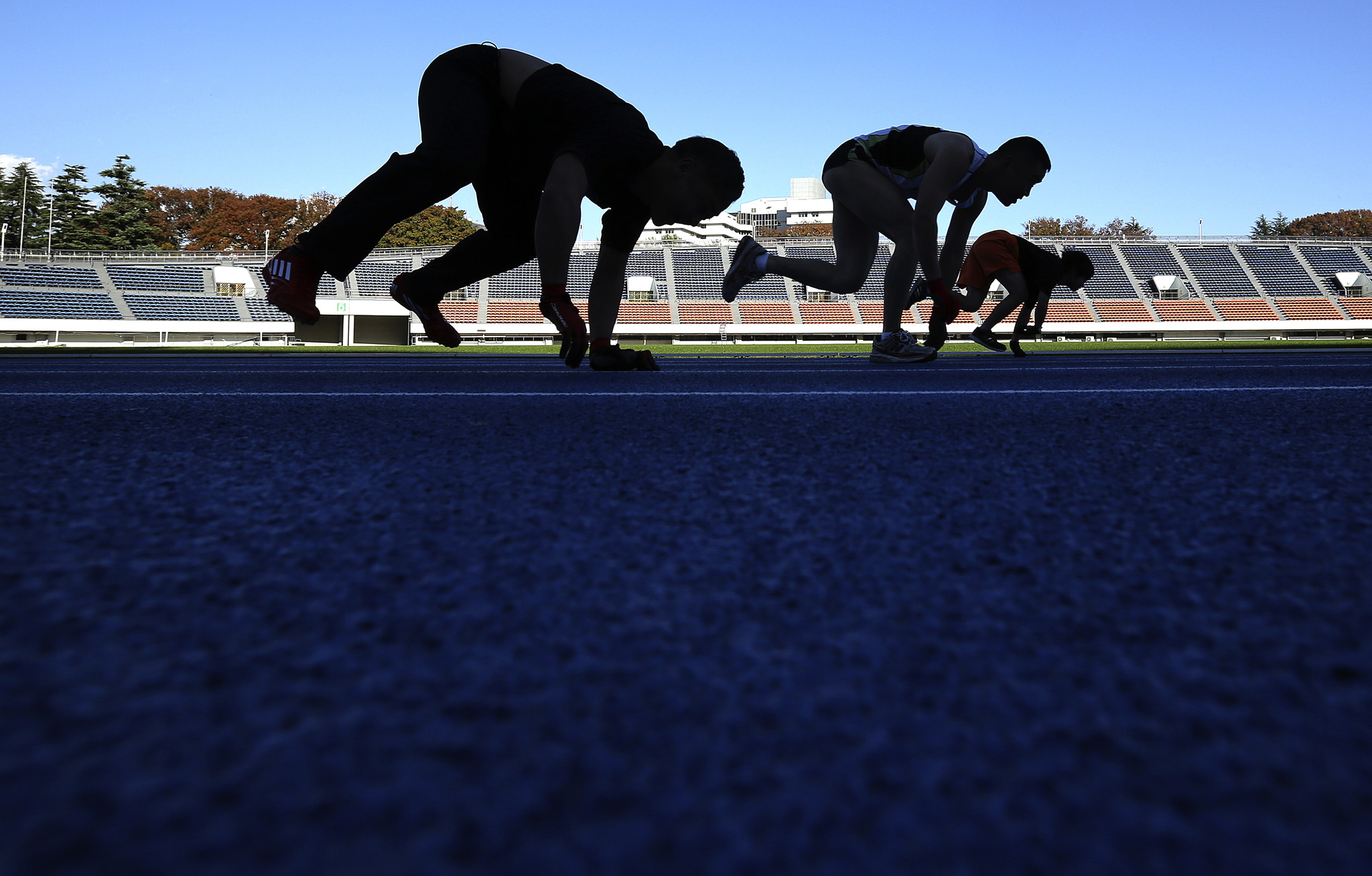 Katsumi Tamakoshi...Competitors run on their arms and legs on a race course in a preliminary race during the Guinness World Record the 100-meter running on all fours at Komazawa Olympic Park Stadium in Tokyo Thursday, Nov. 13, 2014 in celebration of Guinness World Records Day. The 18-year-old Japanese Katsumi Tamakoshi set new record of 15.86 seconds Thursday. (AP Photo/Eugene Hoshiko)