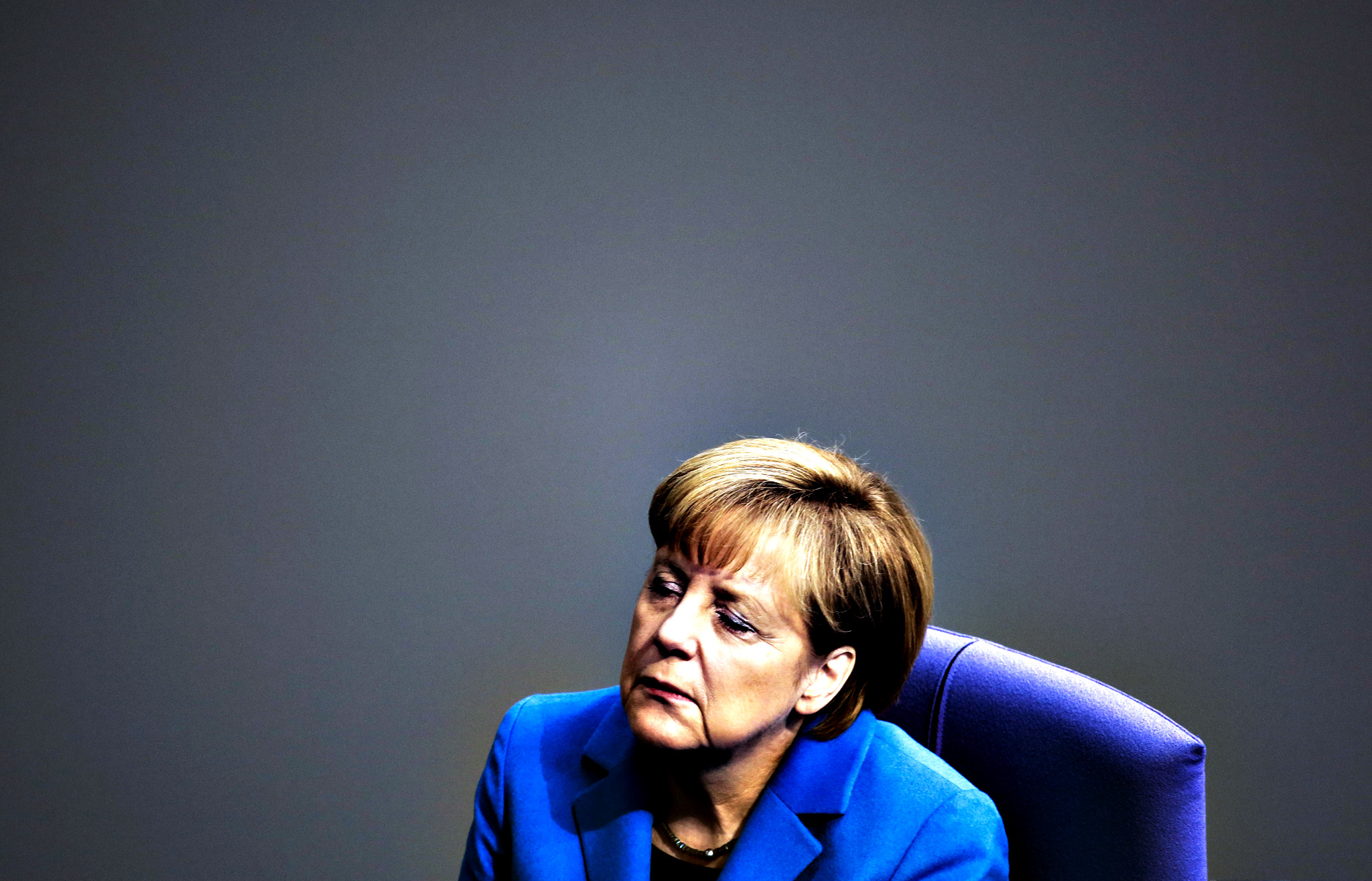 German Chancellor Angela Merkel attends a special session of the German parliament to commemorate the 25th anniversary of the fall of the wall  at the Bundestag in Berlin, Friday, Nov. 7, 2014. On Nov. 9, Germany celebrate the 25th anniversary of the fall of the wall in 1989.