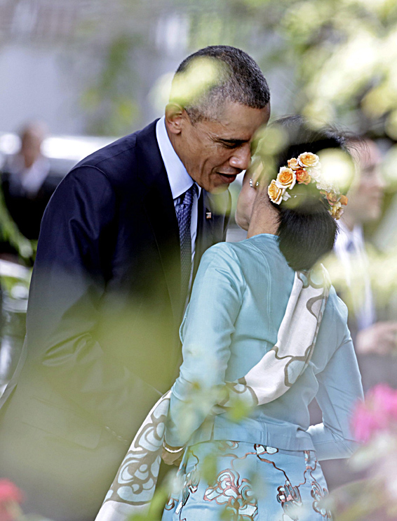 US President Obama visit to Myanmar...epaselect epa04488931 US President Barack Obama (L) and Myanmar opposition leader Aung San Suu Kyi (R) greet each other at the Suu Kyi's resident in Yangon, Myanmar, 14 November 2014. US President Barack Obama is visiting Myanmar from 12 to 14 November 2014 as part of his six-days visit including China and Australia from November 10-16. During his second time visit to Myanmar, Obama attended the East Asia Summit (EAS), the US-ASEAN Summit and held a bilateral meeting with President Thein Sein in Naypyitaw.  EPA/NYEIN CHAN NAING