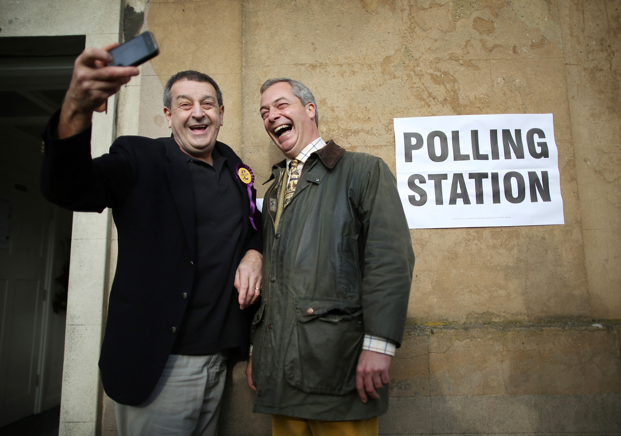 Rochester and Strood Parliamentary By-Election...ROCHESTER, ENGLAND - NOVEMBER 20:  United Kingdom Independence Party (UKIP) leader Nigel Farage (R) poses for a selfie photo with party worker Lee Jarvis at a polling station on November 20, 2014 in Rochester, England. Polls have opened and voting is taking place in the Rochester and Strood parliamentary by-election.  (Photo by Peter Macdiarmid/Getty Images)
