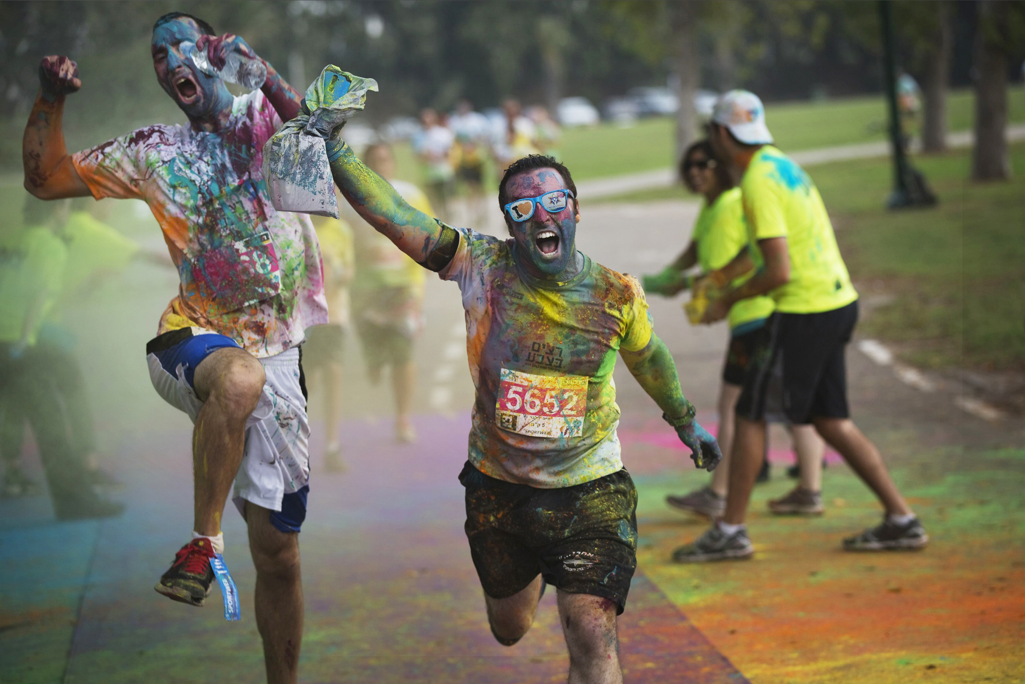 "Participants in an amateur race approach the finish in Tel Aviv...Participants in an amateur ""Running in Color"" event approach the finish line of a five kilometre (three mile) race in Tel Aviv, November 14, 2014. Inspired by the Hindu Holi festival, the race involved participants running along a course dotted with locations where coloured powders were thrown over the runners. The event was held to raise awareness about Post Traumatic Stress Disorder caused by conflict in the country. REUTERS/Finbarr O'Reilly"