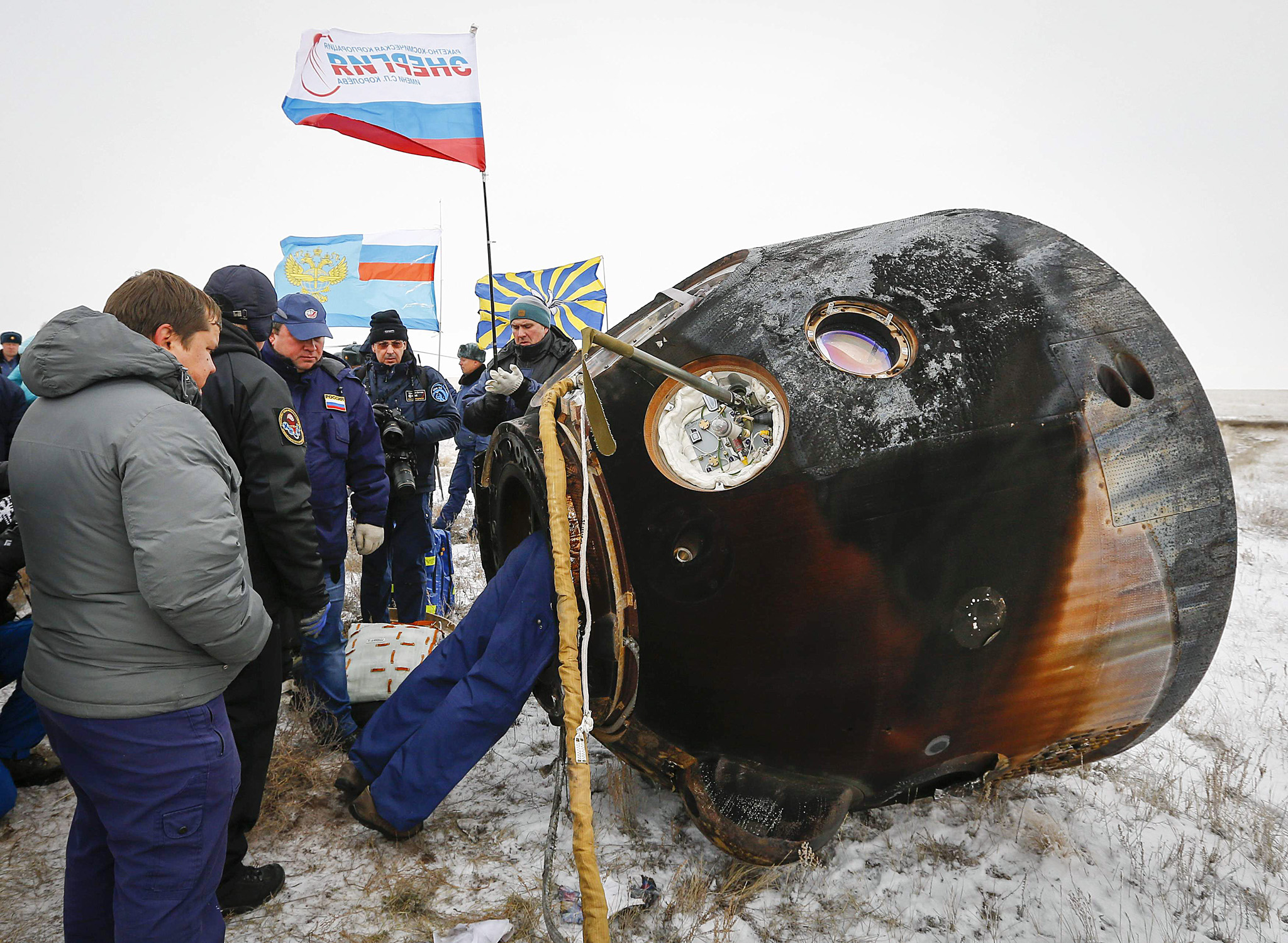 Ground personnel work on November 10, 20...Ground personnel work on November 10, 2014 next to the Soyuz TMA-13M capsule, carrying International Space Station (ISS) crew members of Alexander Gerst of Germany, Maxim Surayev of Russia and Reid Wiseman of the United States, after its landing near the town of Arkalyk in northern Kazakhstan. A veteran Russian cosmonaut and two International Space Station crewmates, one from the United States and one from Germany, returned safely to Earth on November 10 with a parachute landing of their Soyuz capsule in Kazakhstan, ending 5,5 months in orbit.    AFP PHOTO / POOL / SHAMIL ZHUMATOVSHAMIL ZHUMATOV/AFP/Getty Images
