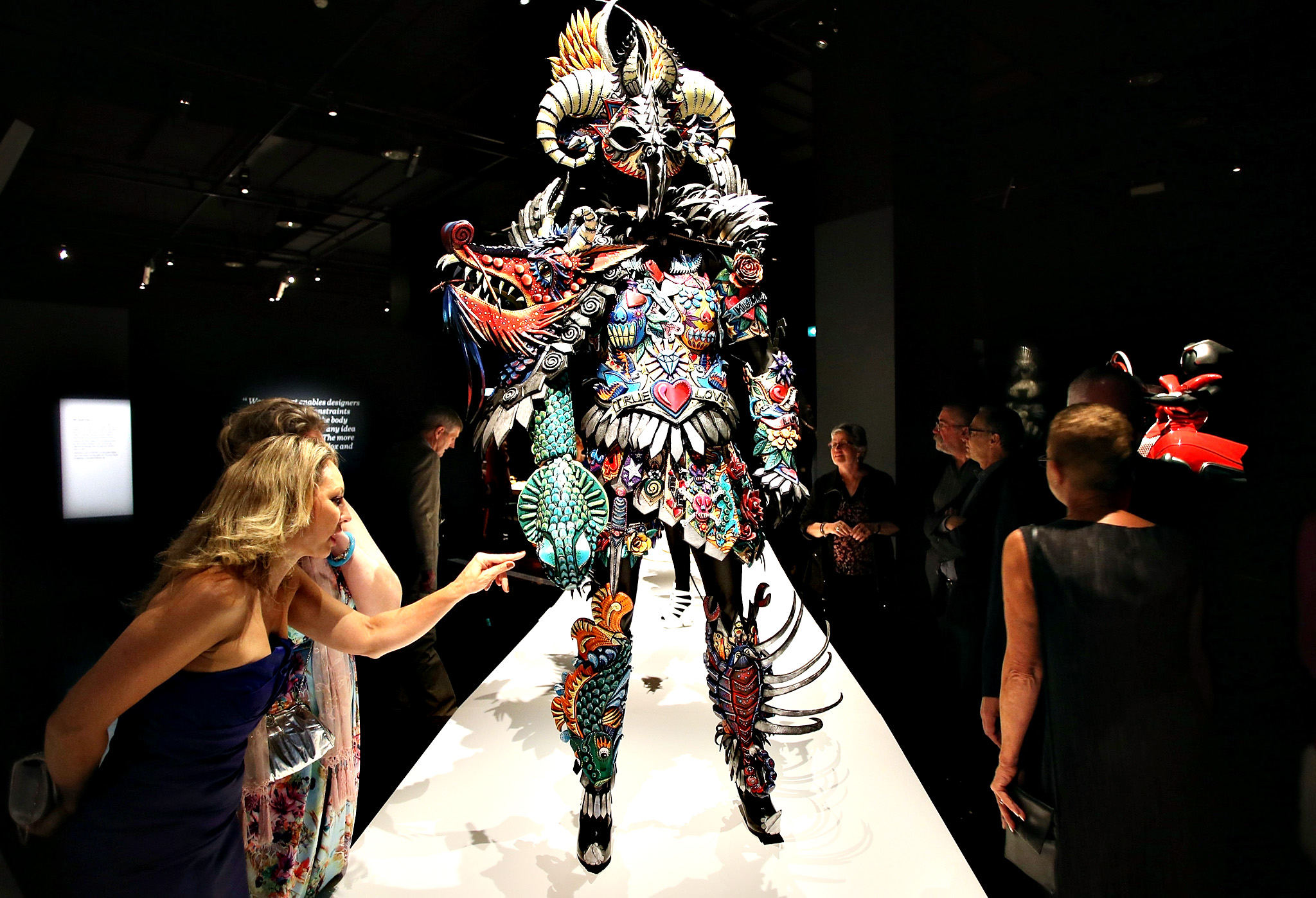 Guests look at the exhibits on show at the Auckland War Memorial Museum's World of Wearable Art (WOW) exhibition opening at Auckland Museum on November 20, 2014 in Auckland, New Zealand.