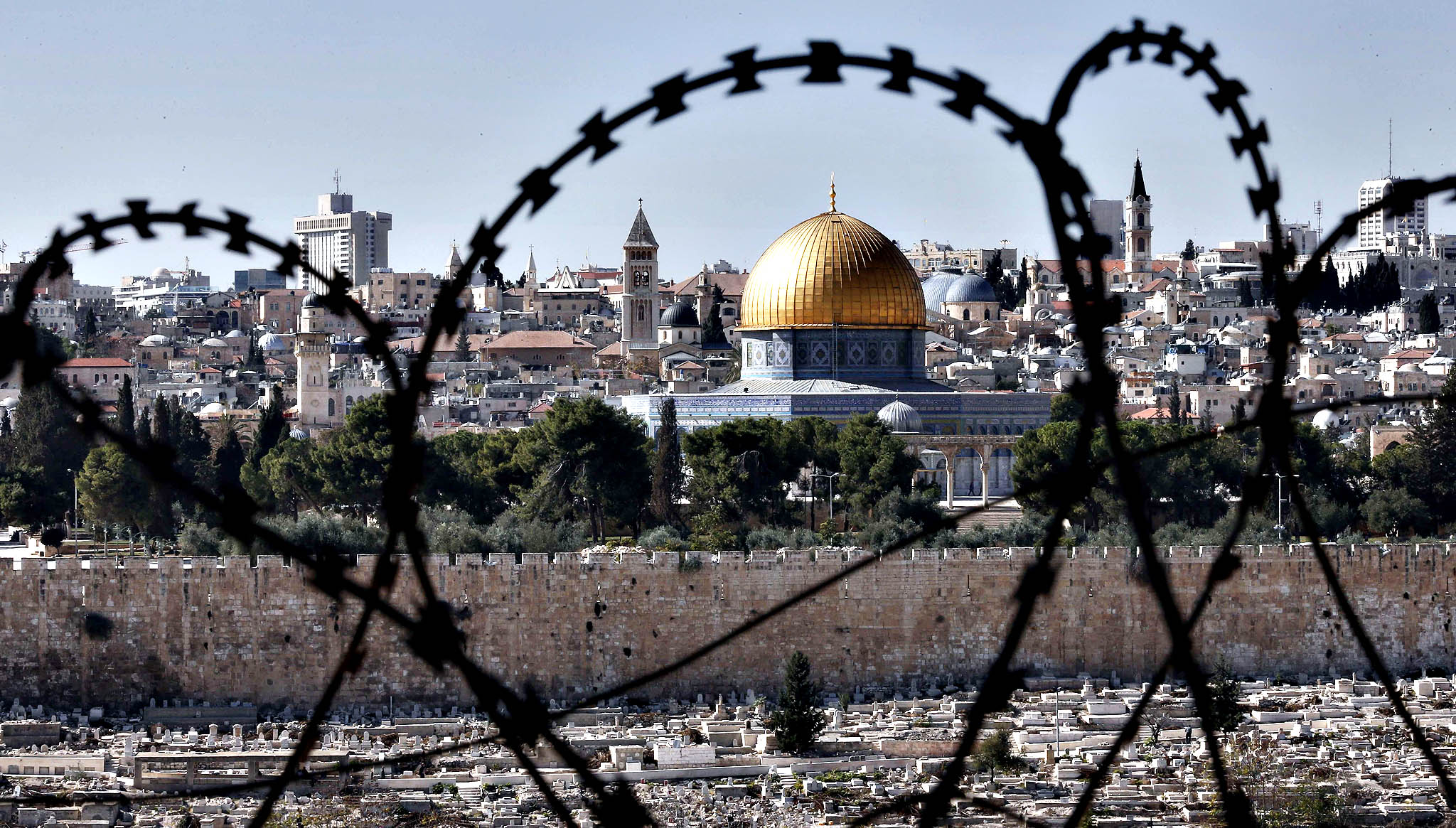 "The Muslim holy site of the Dome of the Rock on the Al Aqsa mosque compound in the Jerusalem Old City is seen through barbed wire on November 10, 2014. The ongoing tension over Jerusalem's flashpoint Al-Aqsa mosque compound is inflicting a ""stab wound"" on the peace treaty between Jordan and Israel, Prime Minister Abdullah Nsur said."