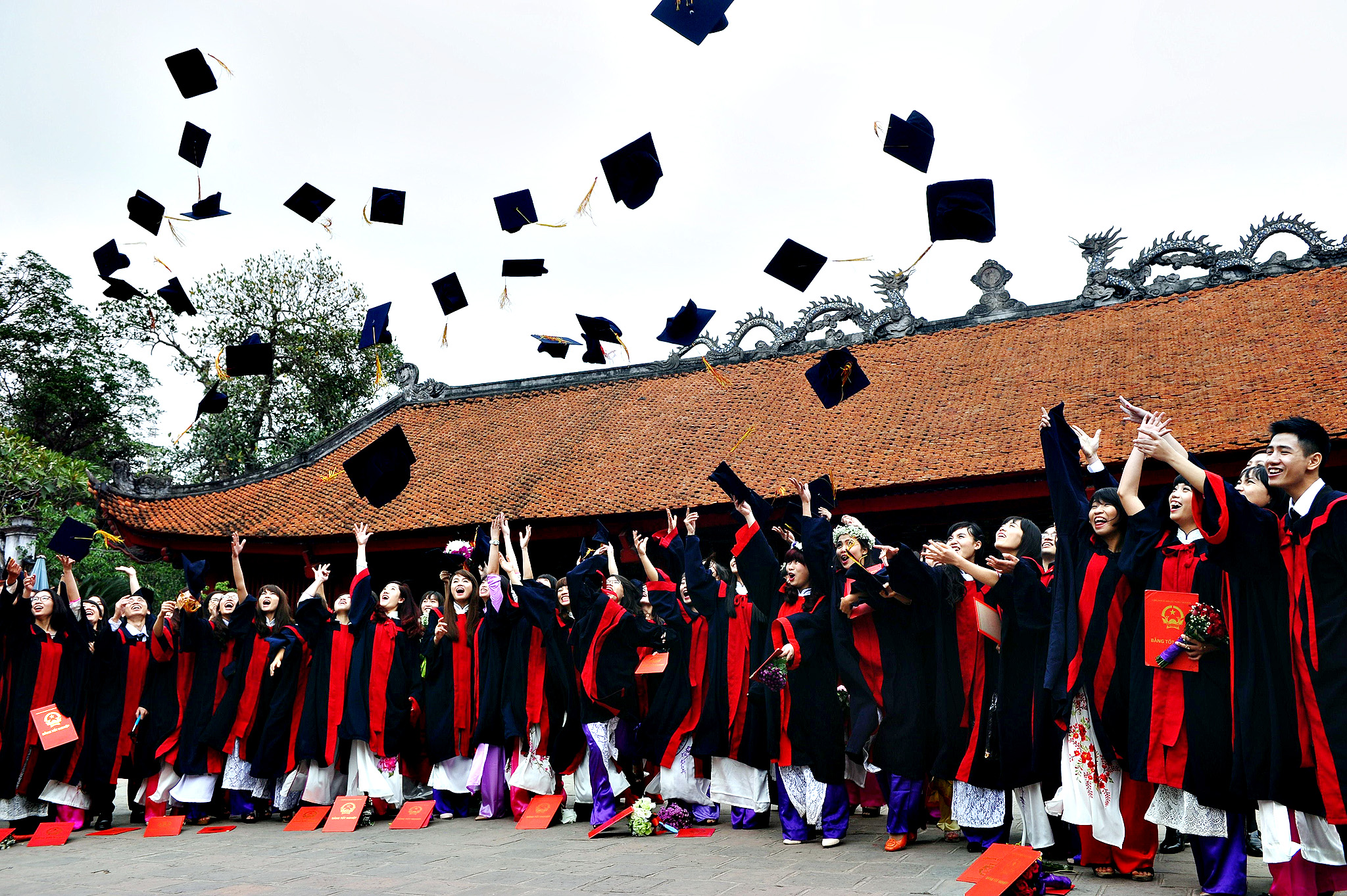 Students from a local college celebrate their graduation at the Temple of Literature in Hanoi on Tuesday. The temple is where Vietnam's oldest university was founded in the 11th century under the Ly Dynasty, and is popular with modern-day students who begin to flock in high school, hoping to boost their chances in annual nationwide examinations.