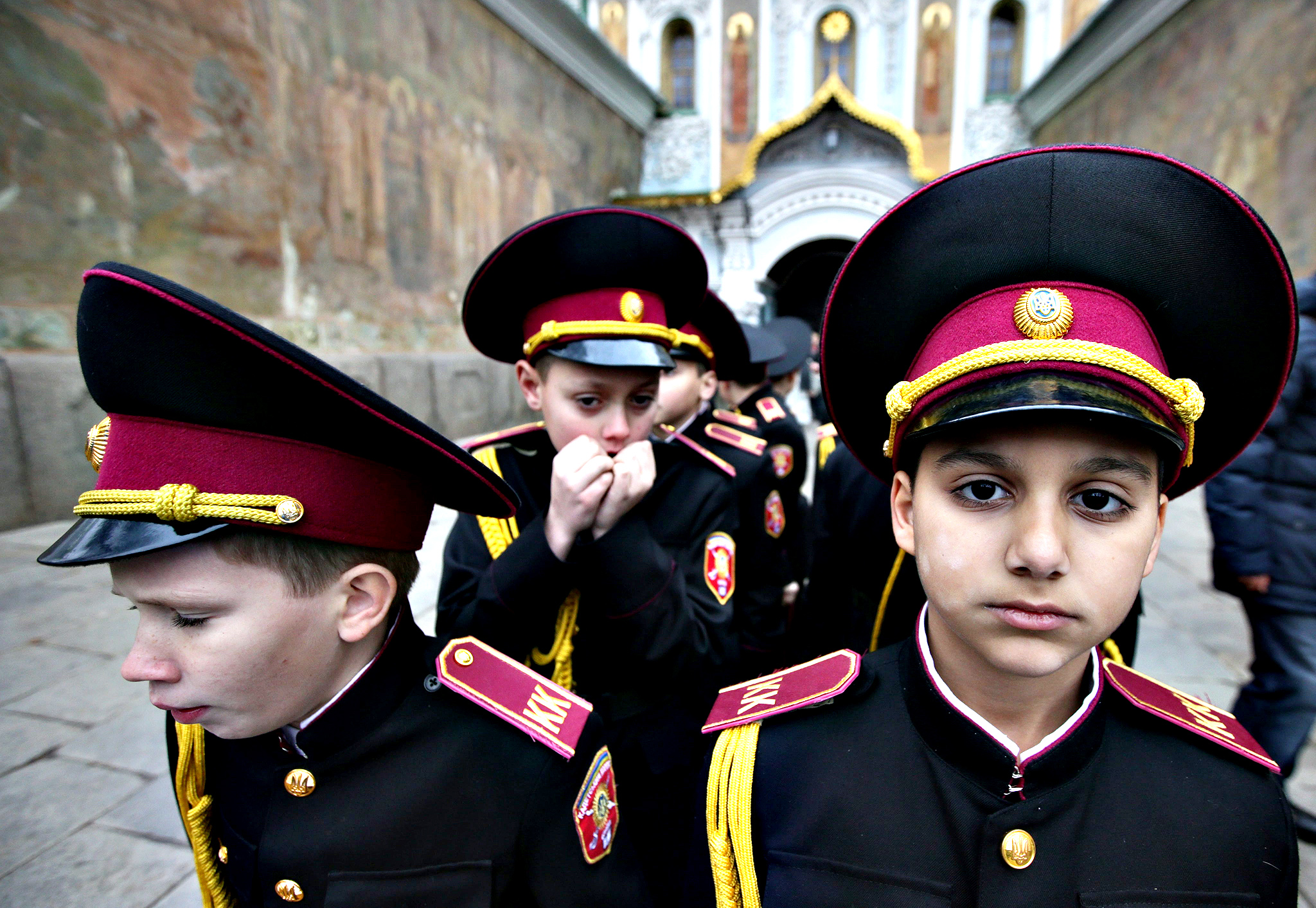 A young Ukrainian cadet warms his hands, after an oath-taking ceremony and a prayer service at Kiev Pechersk Lavra monastery in Kiev, Ukraine, 14  November 2014. About 100 young Ukrainian cadets took part in an oath-taking ceremony, including 10 cadets from the ATO area, local media report.