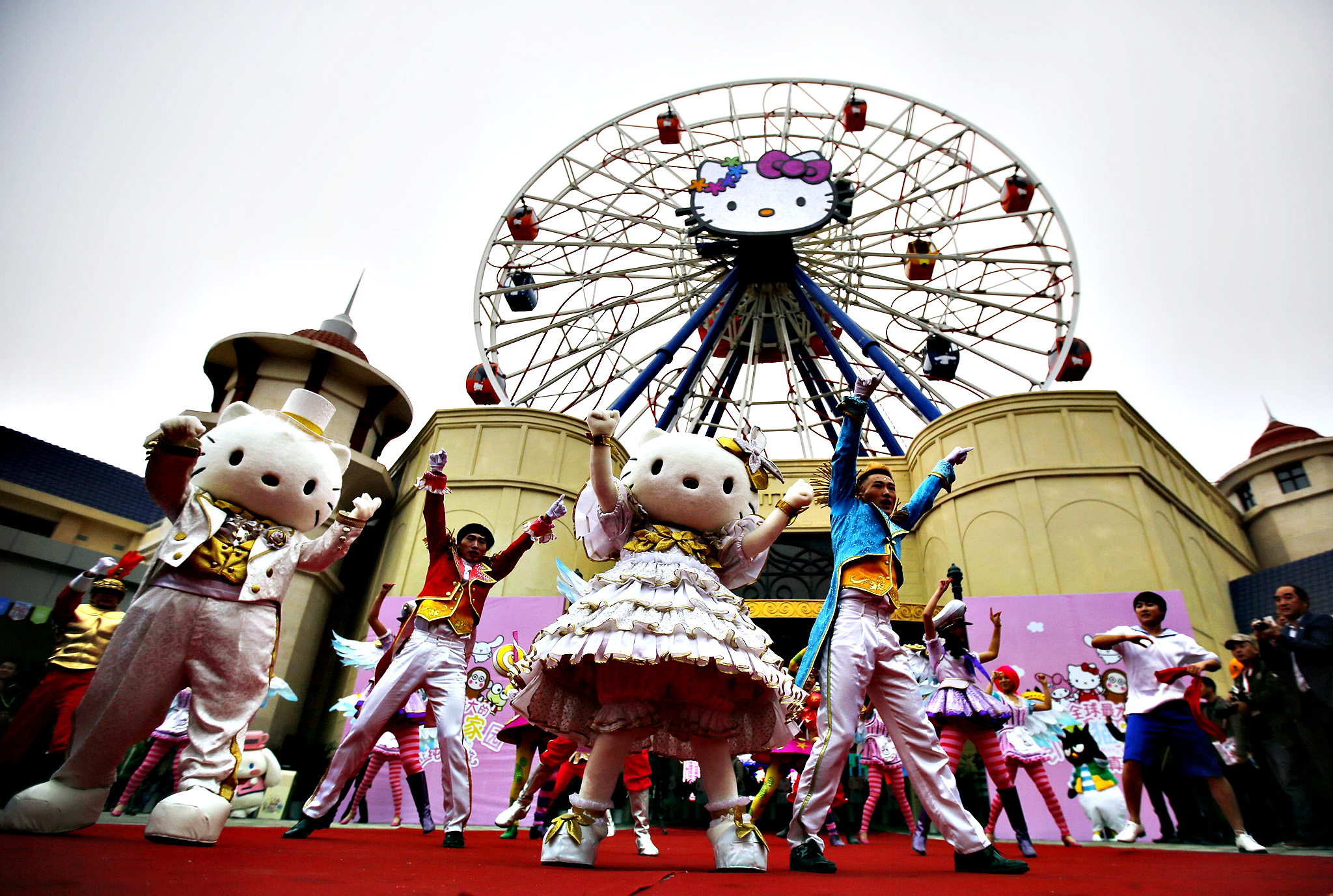 Dancers perform during an inauguration ceremony of a Hello Kitty amusement park in Anji, Zhejiang province November 28, 2014. With an investment of $325 million, Hello Kitty Park will be China's first large scale amusement park scheduled to open to the public on New Year's day. According to state media, there are nearly 60 theme parks being built across China right at the moment.