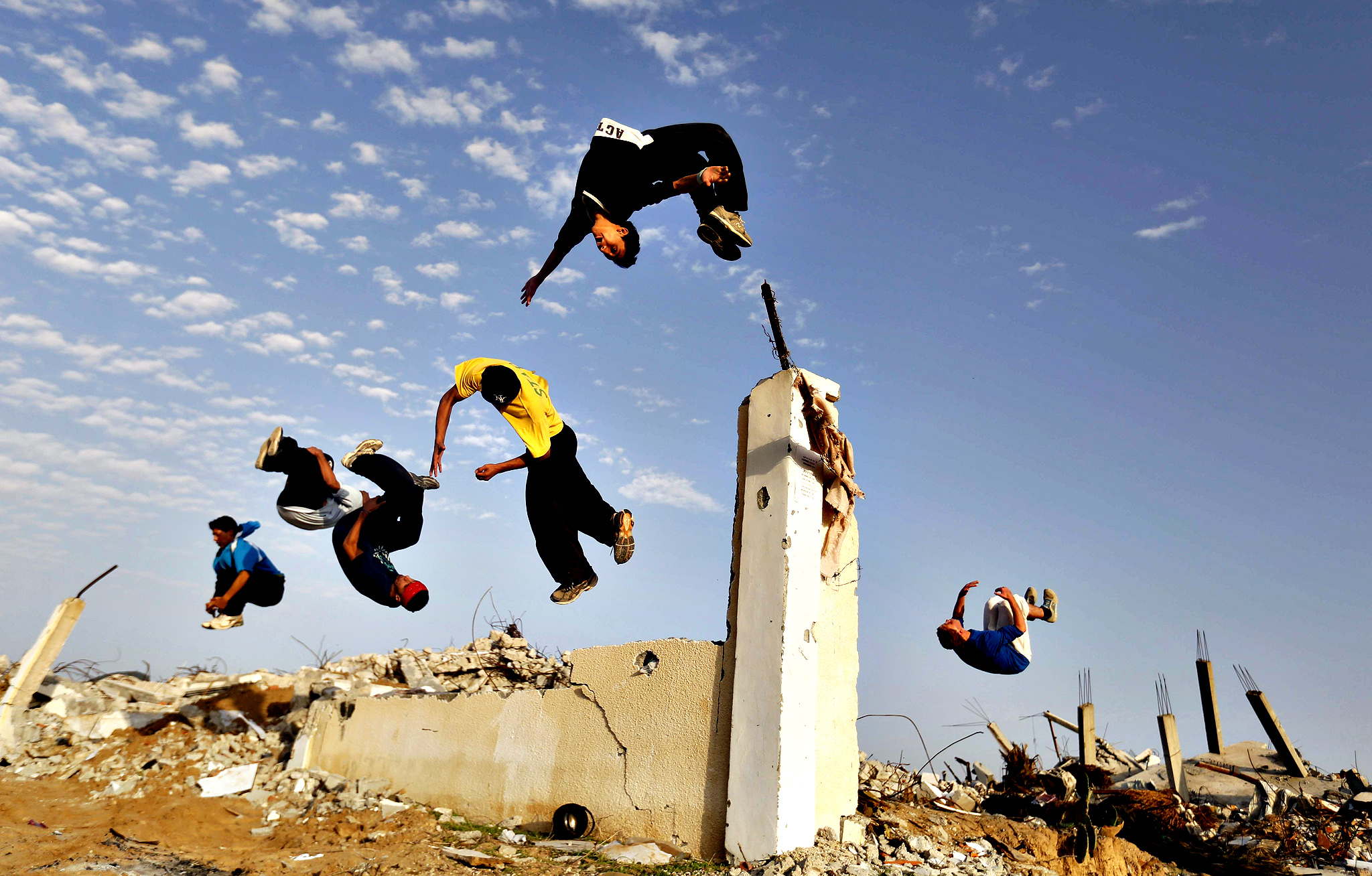 Palestinian youths practice their Parkour skills over the ruins of houses, which were destroyed during the 50-day Gaza war between Israel and Hamas-led militants in the Gaza Strip, on November 14, 2014, in Khan Yunis' Khuzaa neighbourhood in the southern Gaza Strip near the Israeli border. The 50-day war between Israel and Hamas militants killed at least 2,143 Palestinians, nearly 70 percent of them civilians, and 73 people on the Israeli side.